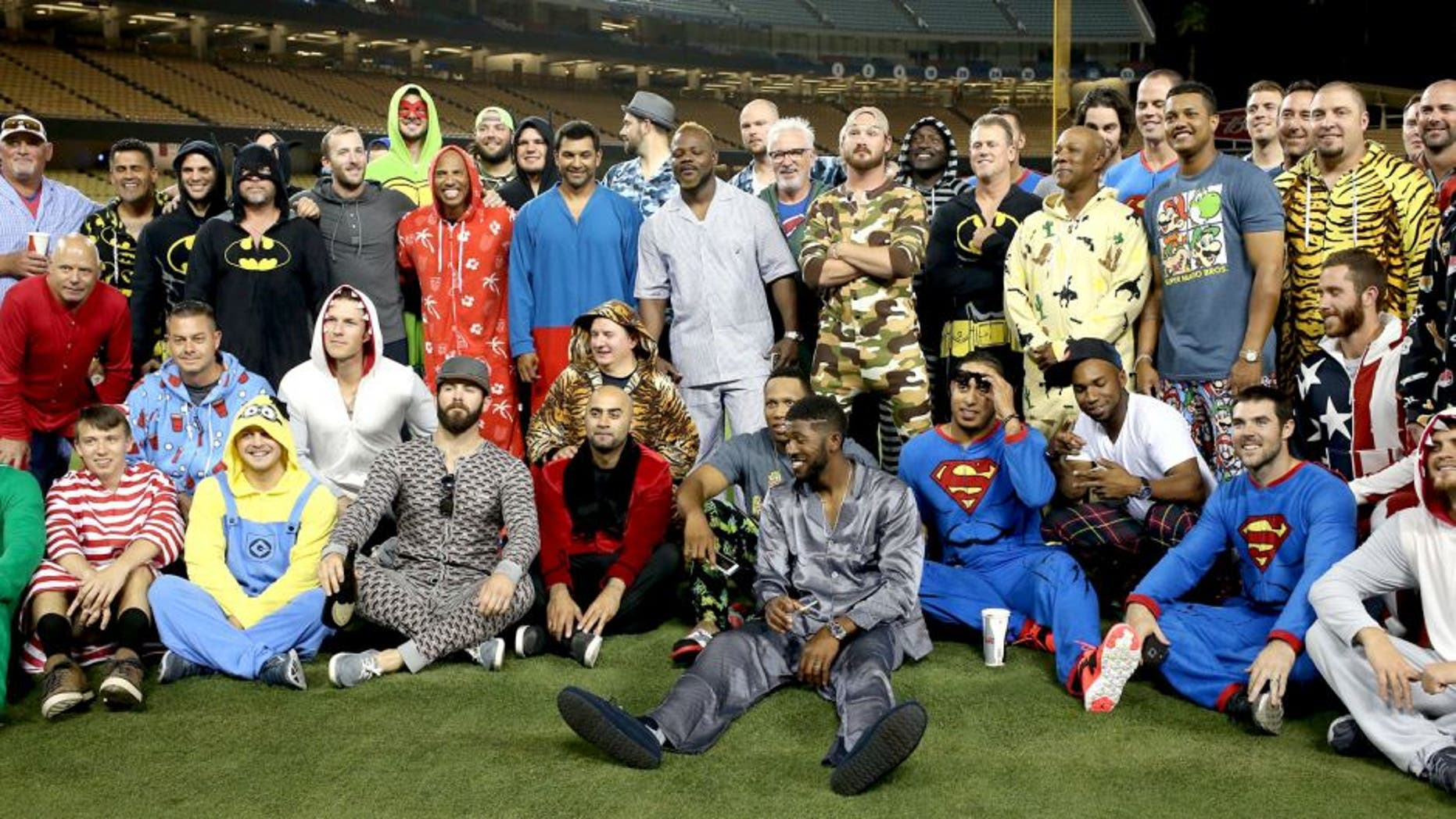 LOS ANGELES, CA - AUGUST 30: The Chicago Cubs pose for a team photo as they wear pajamas as part of a theme trip as they prepare to leave town after the game against the Los Angeles Dodgers at Dodger Stadium on August 30, 2015 in Los Angeles, California. Seated third from left with a gray hat and his hand on a bottle is pitcher Jake Arrieta #49, who had just pitched a no hitter in the game. The Cubs won 2-0. (Photo by Stephen Dunn/Getty Images)