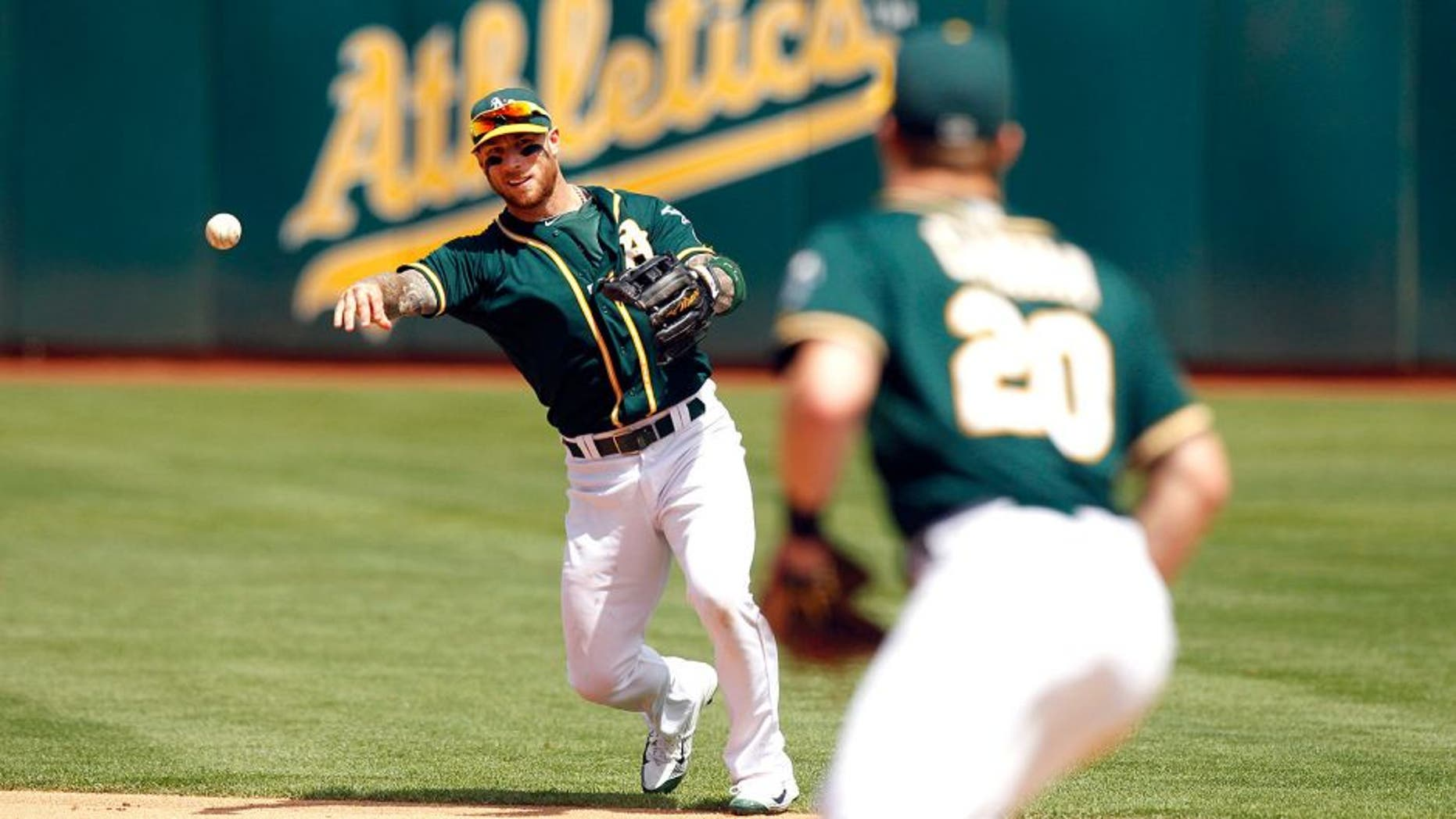 Aug 23, 2015; Oakland, CA, USA; Oakland Athletics infielder Brett Lawrie (15) throws the ball to first to record an out against the Tampa Bay Rays in the fifth inning at O.co Coliseum. The Athletics defeated the Rays 8-2. Mandatory Credit: Cary Edmondson-USA TODAY Sports