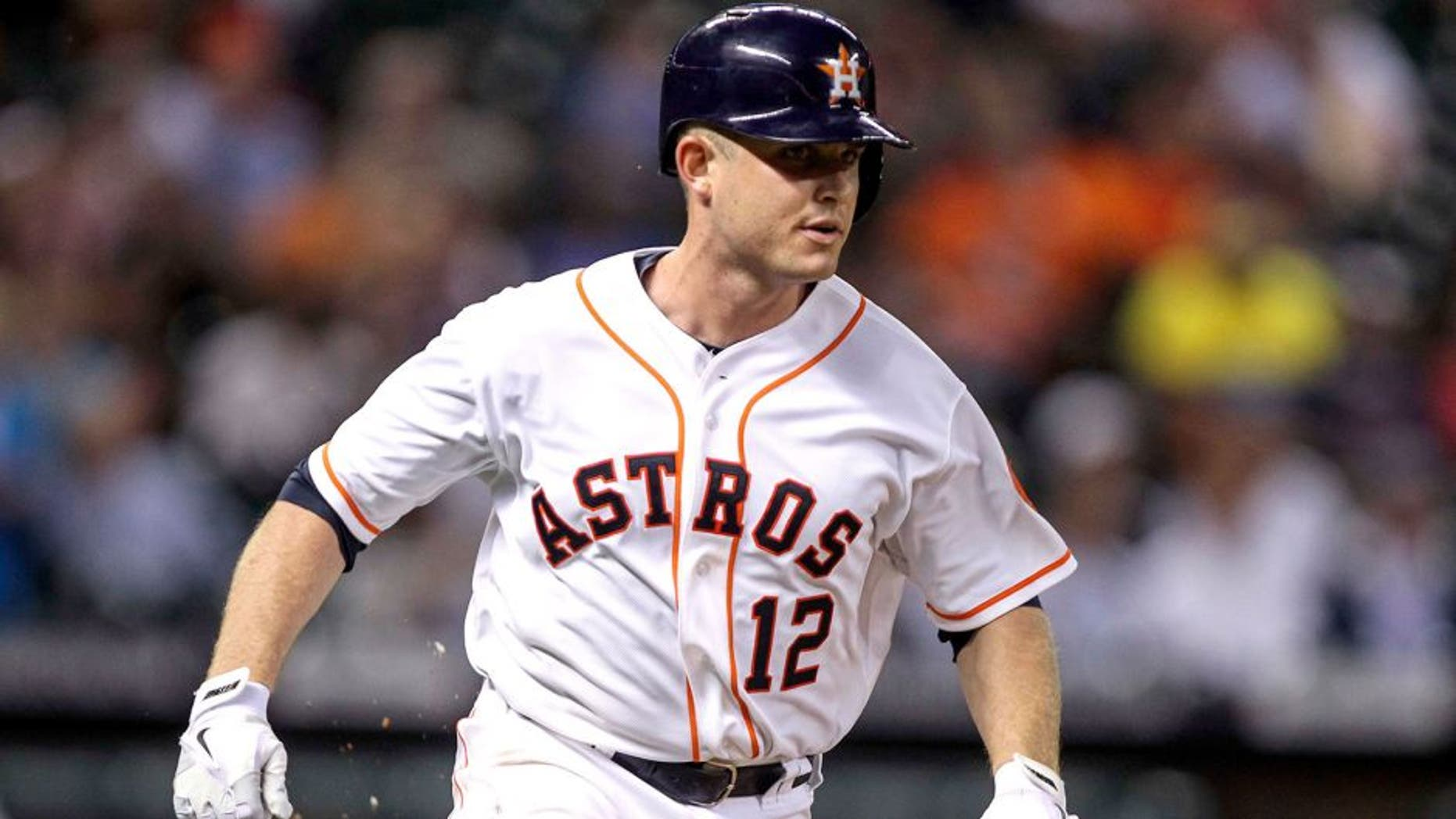 Sep 16, 2014; Houston, TX, USA; Houston Astros catcher Max Stassi (12) runs to first base with a single during the fourth inning against the Cleveland Indians at Minute Maid Park. Mandatory Credit: Troy Taormina-USA TODAY Sports