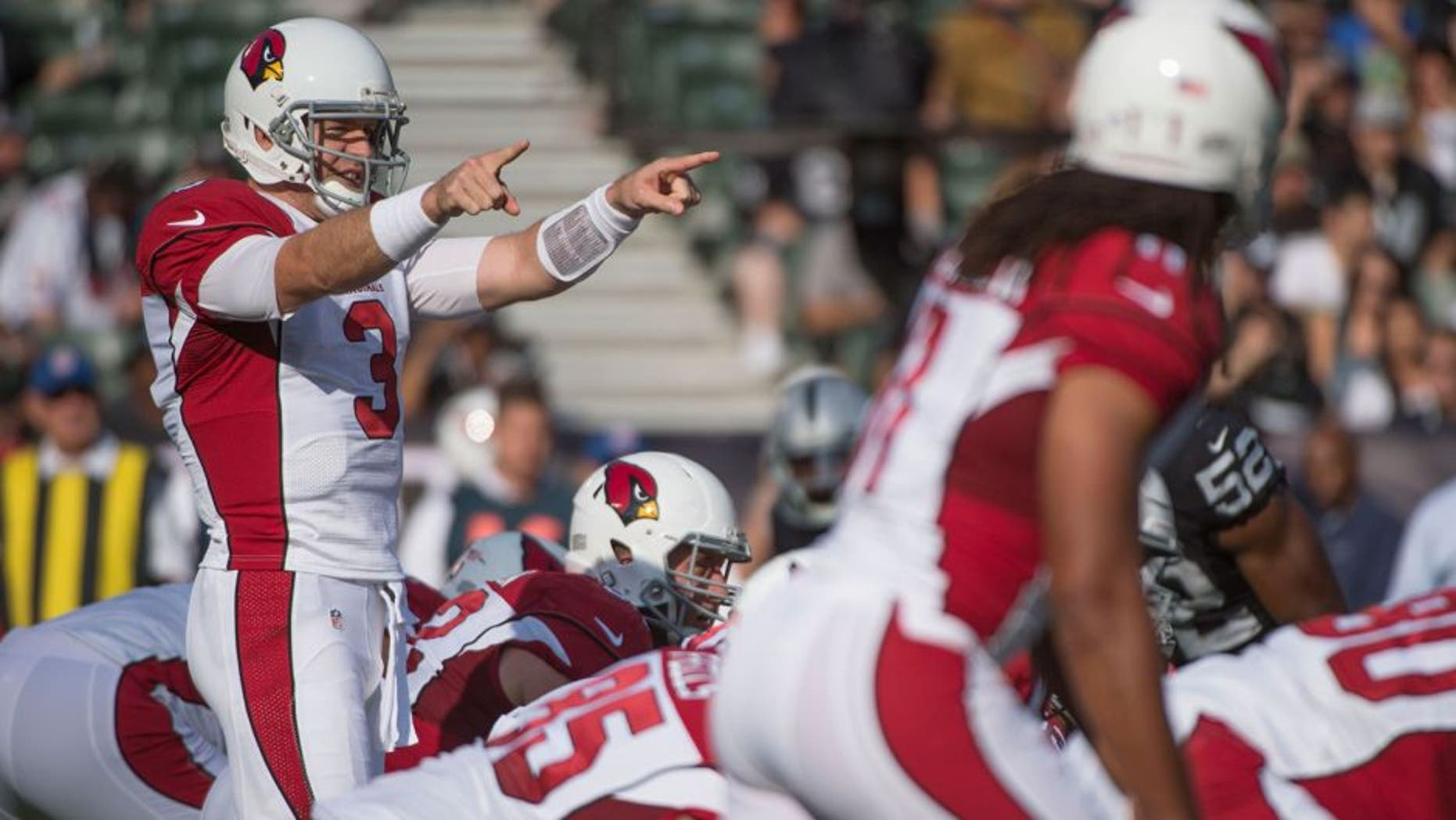 August 30, 2015; Oakland, CA, USA; Arizona Cardinals quarterback Carson Palmer (3) signals at the line of scrimmage against the Oakland Raiders during the first quarter in a preseason NFL football game at O.co Coliseum. Mandatory Credit: Kyle Terada-USA TODAY Sports