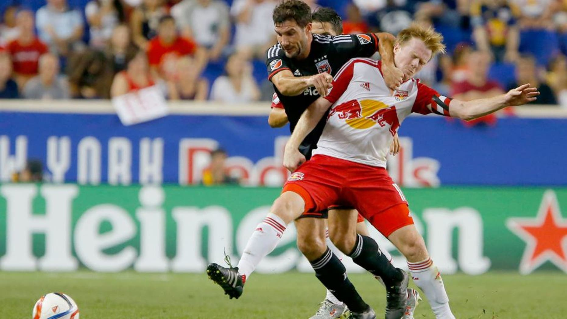 Aug 30, 2015; Harrison, NJ, USA; D.C. United midfielder/forward Chris Pontius (13) and New York Red Bulls midfielder Dax McCarty (11) battle for the ball during first half at Red Bull Arena. Mandatory Credit: Noah K. Murray-USA TODAY Sports