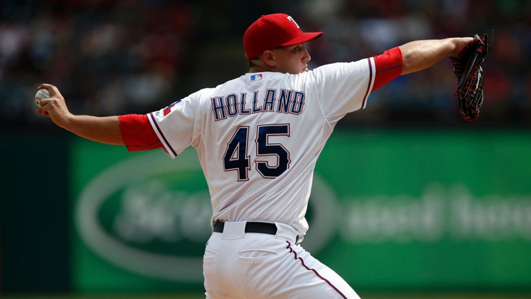 Aug 30, 2015; Arlington, TX, USA; Texas Rangers starting pitcher Derek Holland (45) delivers a pitch to the Baltimore Orioles during the fifth inning of a ballgame at Globe Life Park in Arlington. The Rangers won 6-0. Mandatory Credit: Jim Cowsert-USA TODAY Sports