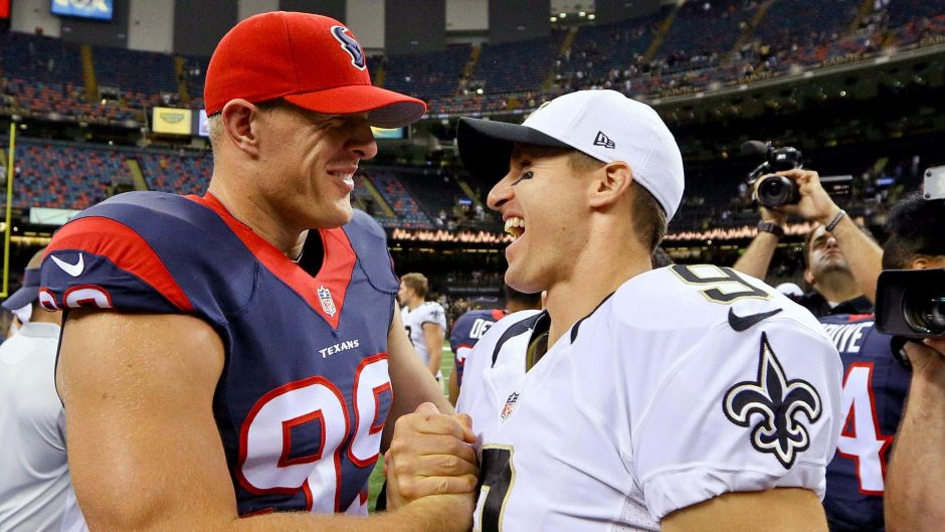 Aug 30, 2015; New Orleans, LA, USA; New Orleans Saints quarterback Drew Brees (9) and Houston Texans defensive end J.J. Watt (99) talk following a preseason game at the Mercedes-Benz Superdome. The Texans defeated the Saints 27-13. Mandatory Credit: Derick E. Hingle-USA TODAY Sports