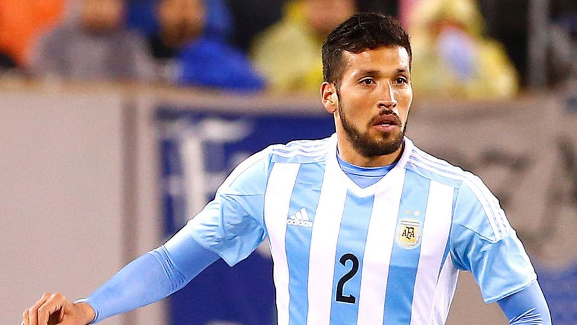 EAST RUTHERFORD, UNITED STATES - MARCH 31: Ezequiel Garay #2 of Argentina moves the ball against Ecuador in the second half during an international friendly match between Argentina and Ecuador at Metlife Stadium on March 31, 2015 in East Rutherford, United States. Argentina defeated Ecuador 2-1. (Photo by Rich Schultz/LatinContent/Getty Images)