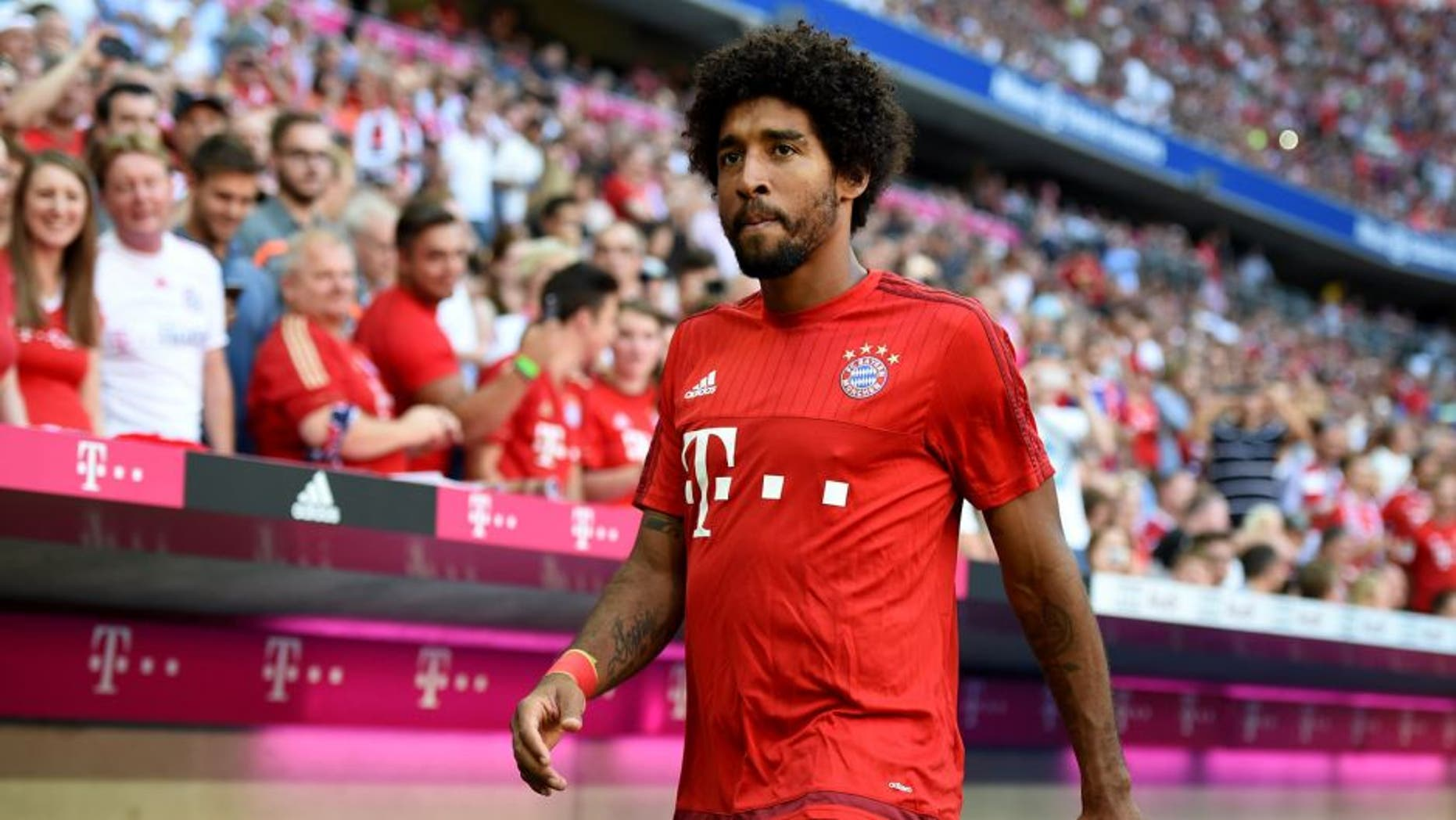 MUNICH, GERMANY - AUGUST 29: Dante of Bayern Muenchen looks on before the Bundesliga match between FC Bayern Muenchen and Bayer Leverkusen at Allianz Arena on August 29, 2015 in Munich, Germany. (Photo by Matthias Hangst/Bongarts/Getty Images)