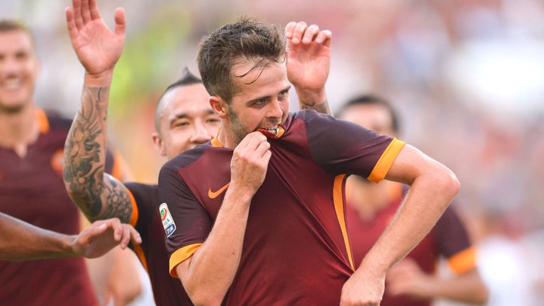 ROME, ITALY - AUGUST 30: AS Roma Player Miralem Pjanic celebrates the goal during the Serie A match between AS Roma and Juventus FC at Stadio Olimpico on August 30, 2015 in Rome, Italy. (Photo by Luciano Rossi/AS Roma via Getty Images)