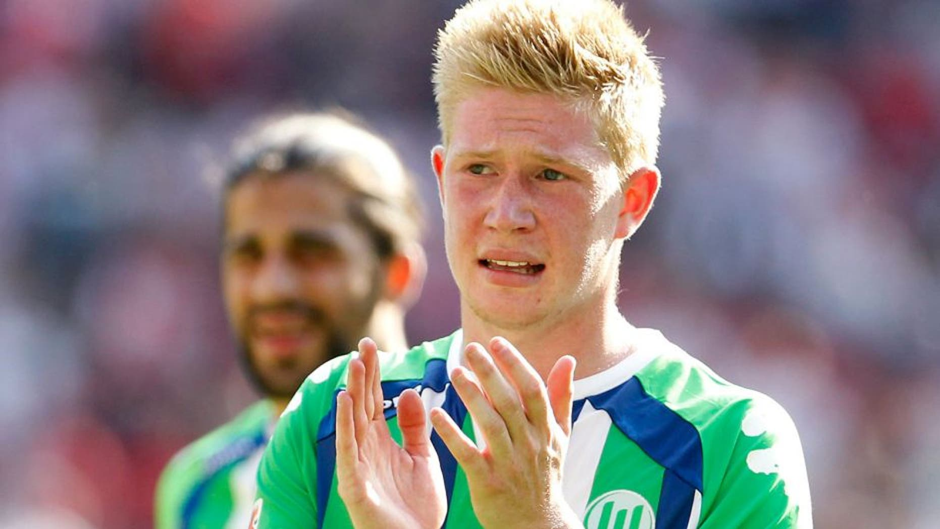 COLOGNE, GERMANY - AUGUST 22: Kevin De Bruyne of Wolfsburg claps after the Bundesliga match between 1. FC Koeln and VfL Wolfsburg at RheinEnergieStadion on August 22, 2015 in Cologne, Germany. (Photo by Mika Volkmann/Bongarts/Getty Images)