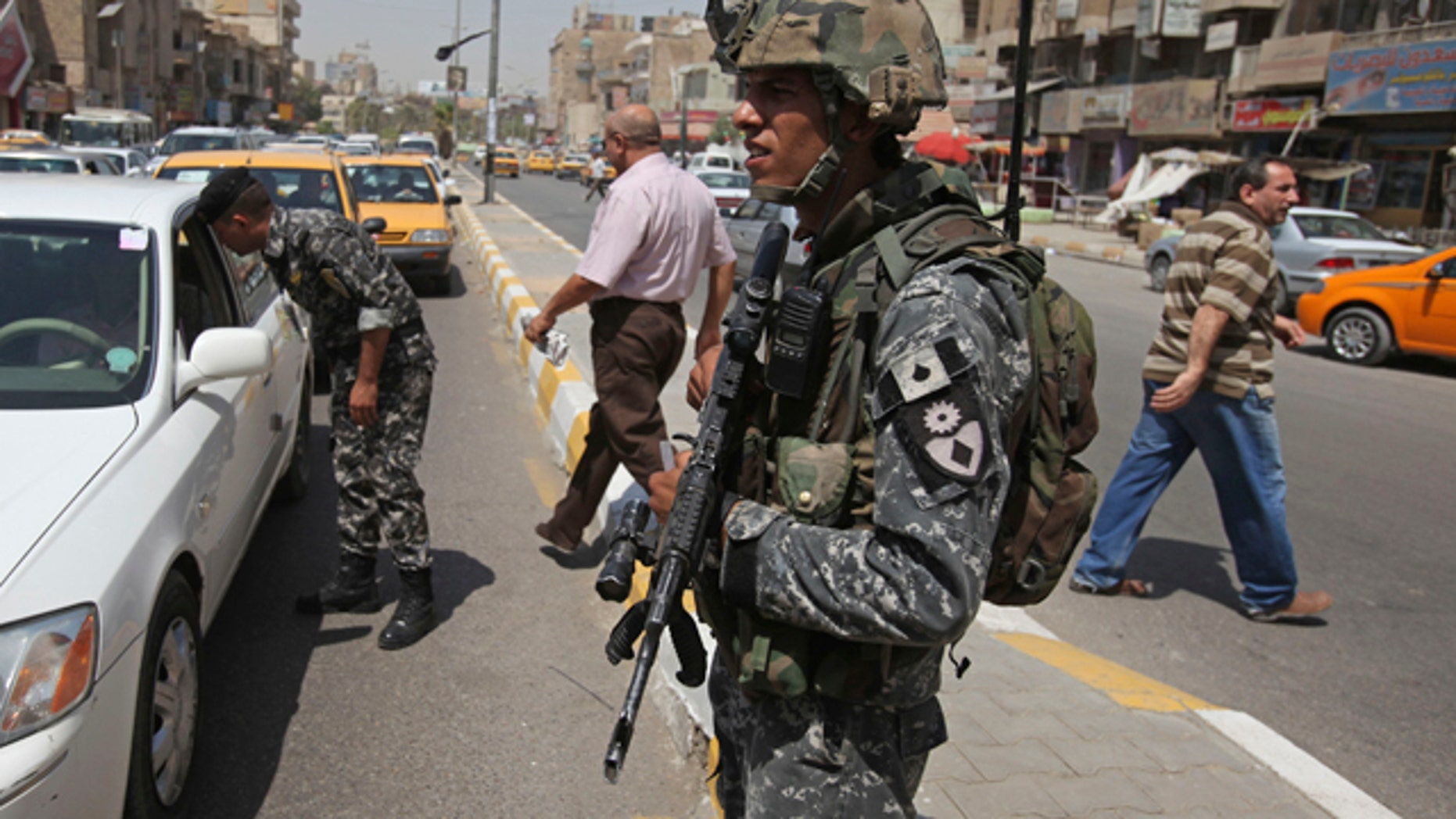 Aug. 31: An Iraqi police officer stands at a checkpoint in Baghdad, Iraq.
