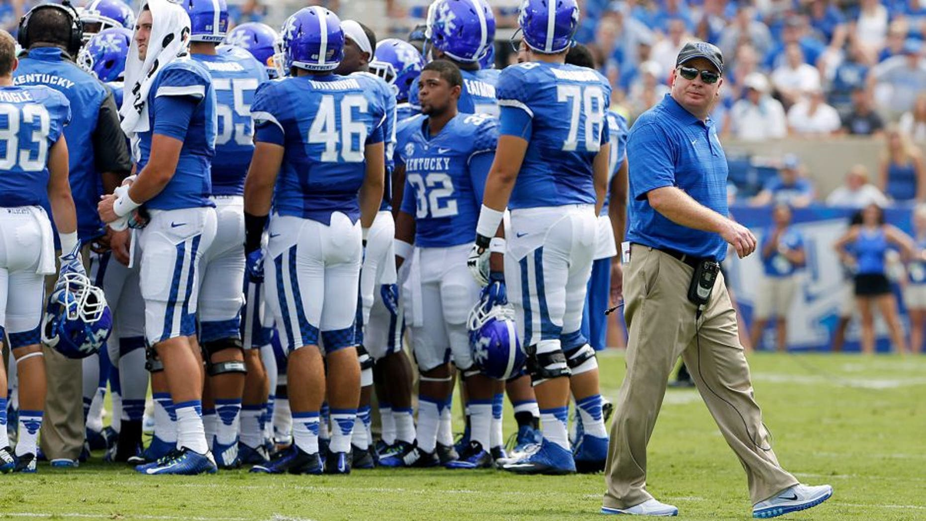 Aug 30, 2014; Lexington, KY, USA; Kentucky Wildcats head coach Mark Stoops during a time out in the game against the UT Martin Skyhawks in the second half at Commonwealth Stadium. Kentucky defeated UT Martin 59-14. Mandatory Credit: Mark Zerof-USA TODAY Sports