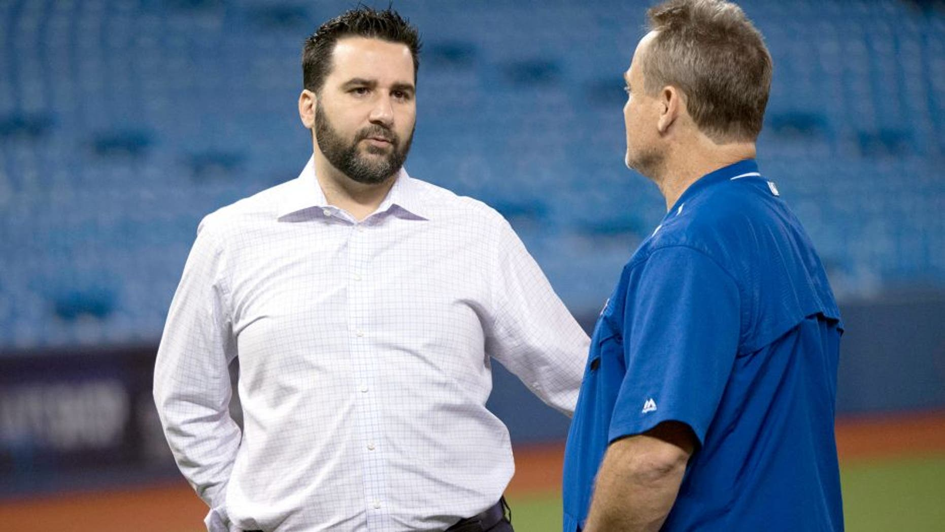 Aug 1, 2015; Toronto, Ontario, CAN; Toronto Blue Jays general manager Alex Anthopoulos talks with Toronto Blue Jays manager John Gibbons (right) during batting practice before a game against the Kansas City Royals at Rogers Centre. The Kansas City Royals won 7-6. Mandatory Credit: Nick Turchiaro-USA TODAY Sports