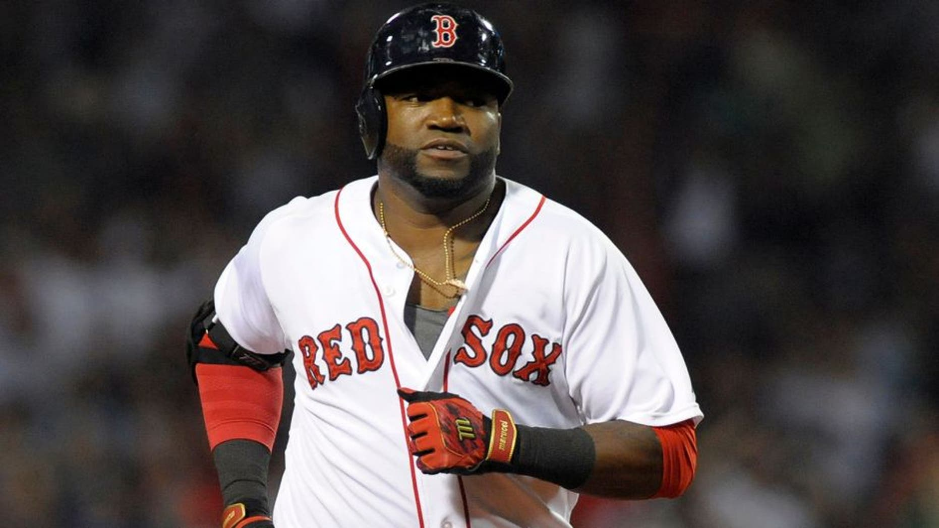 Aug 31, 2015; Boston, MA, USA; Boston Red Sox designated hitter David Ortiz (34) rounds the bases after hitting a home run during the fourth inning against the New York Yankees at Fenway Park. Mandatory Credit: Bob DeChiara-USA TODAY Sports