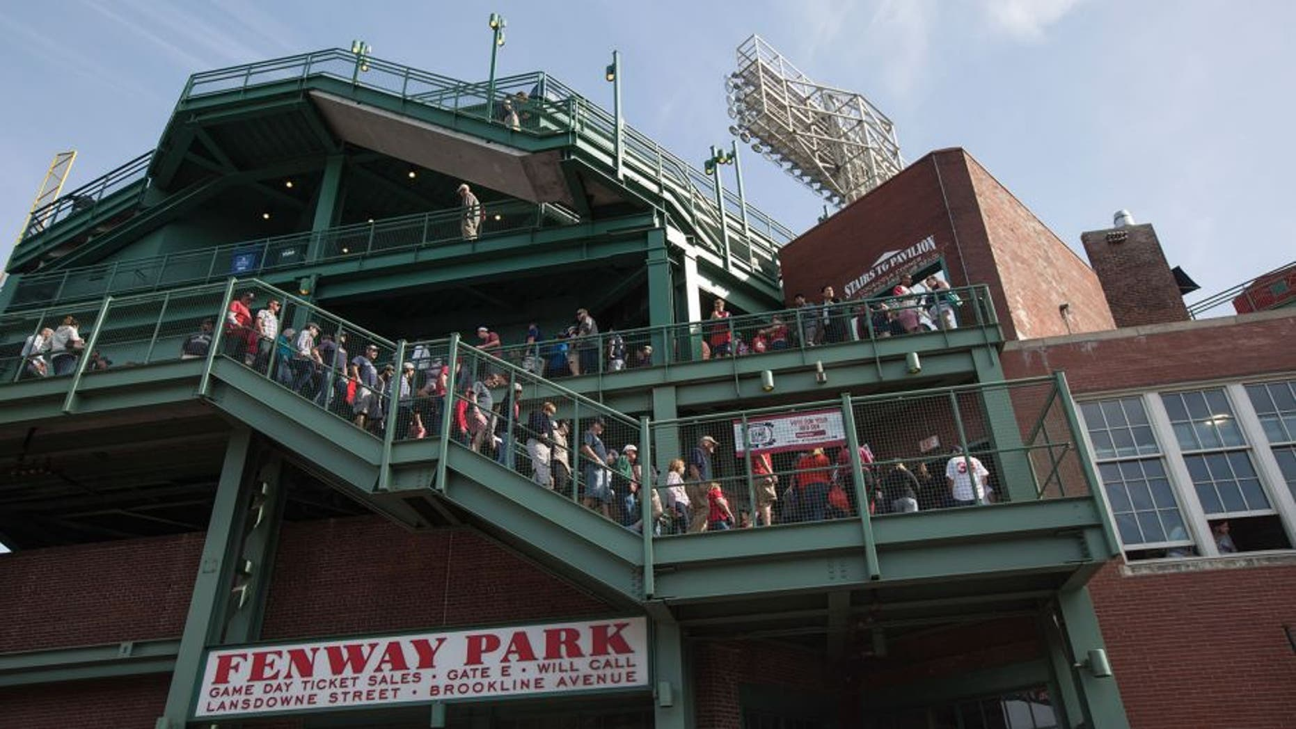 BOSTON - JUNE 7: Fans walk through Fenway Park in Boston, Mass., June 7, 2015. A little known, more than a century old so-called baseball rule, states that stadium owners and operators are not responsible for injuries sustained by foul balls or shards of bat so long as netted or screened seats are available to the vast majority of spectators. (Photo by Keith Bedford for The Boston Globe via Getty Images)