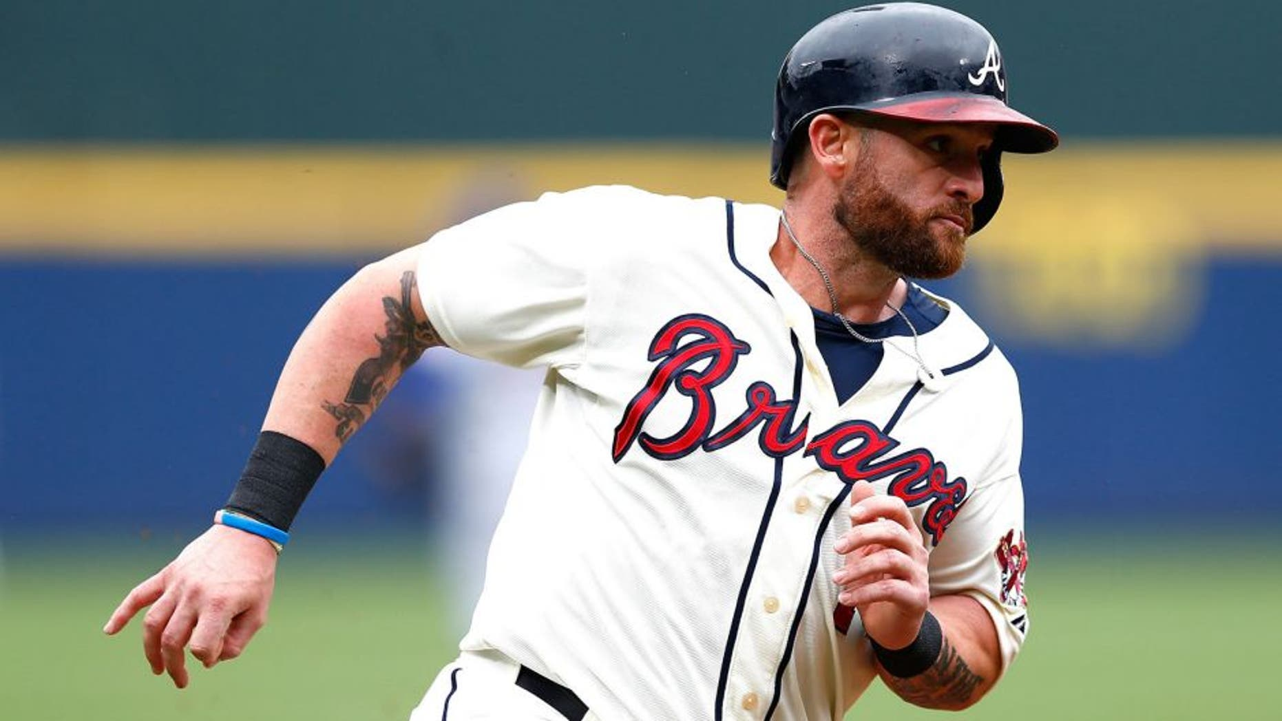 ATLANTA, GA - APRIL 12: Jonny Gomes #7 of the Atlanta Braves in action against the New York Mets during the Braves opening series at Turner Field on April 12, 2015 in Atlanta, Georgia. (Photo by Kevin C. Cox/Getty Images)