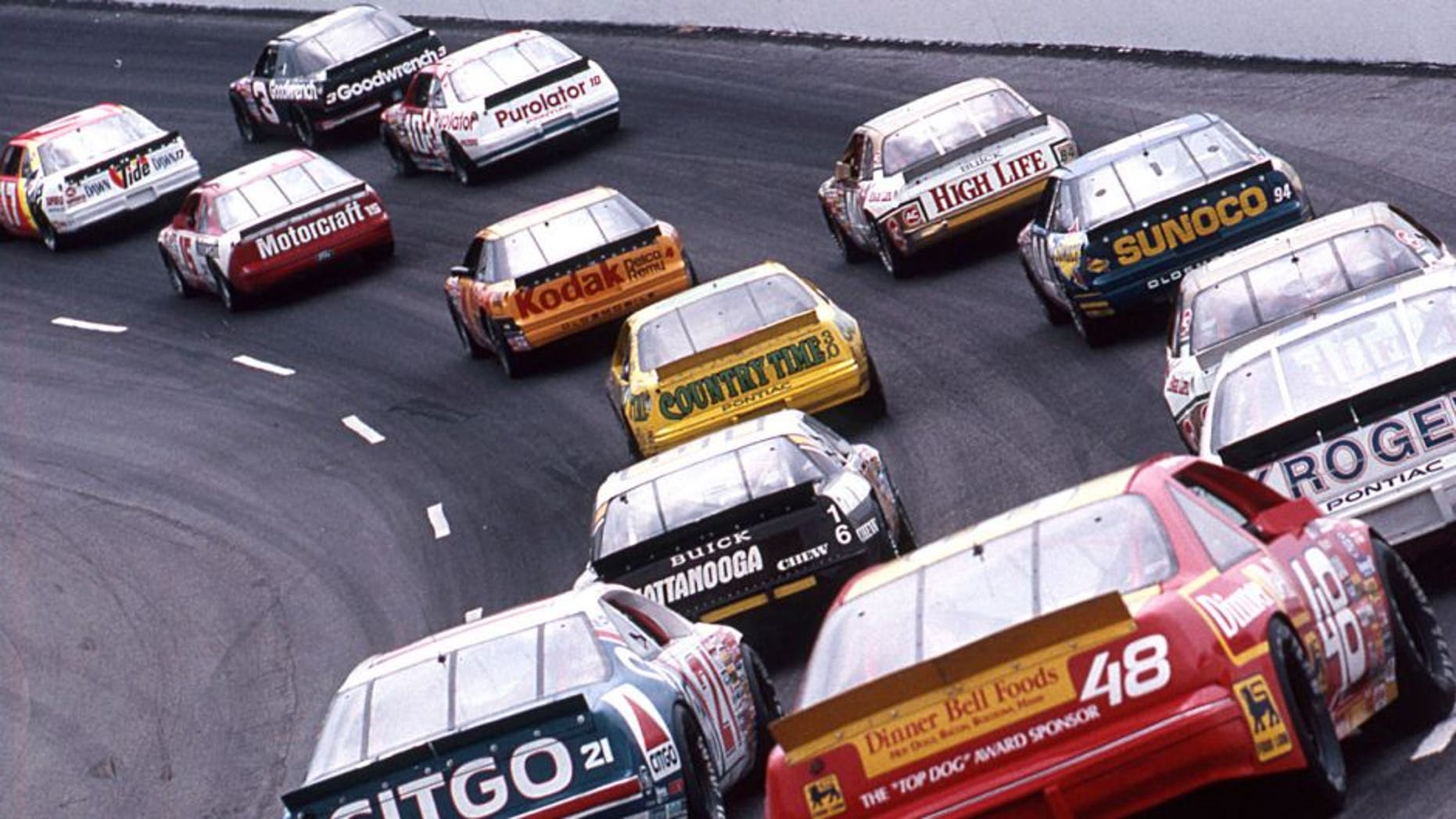DARLINGTON, SC - SEPTEMBER 2, 1989: Greg Sacks (No. 17), Dale Earnhardt (No. 3), Morgan Shepherd (No. 15) and Derrike Cope (No. 10) lead the field during the running of the Heinz Southern 500 NASCAR Cup race at Darlington Raceway. Earnhardt went on to score the victory. (Photo by ISC Images & Archives via Getty Images)