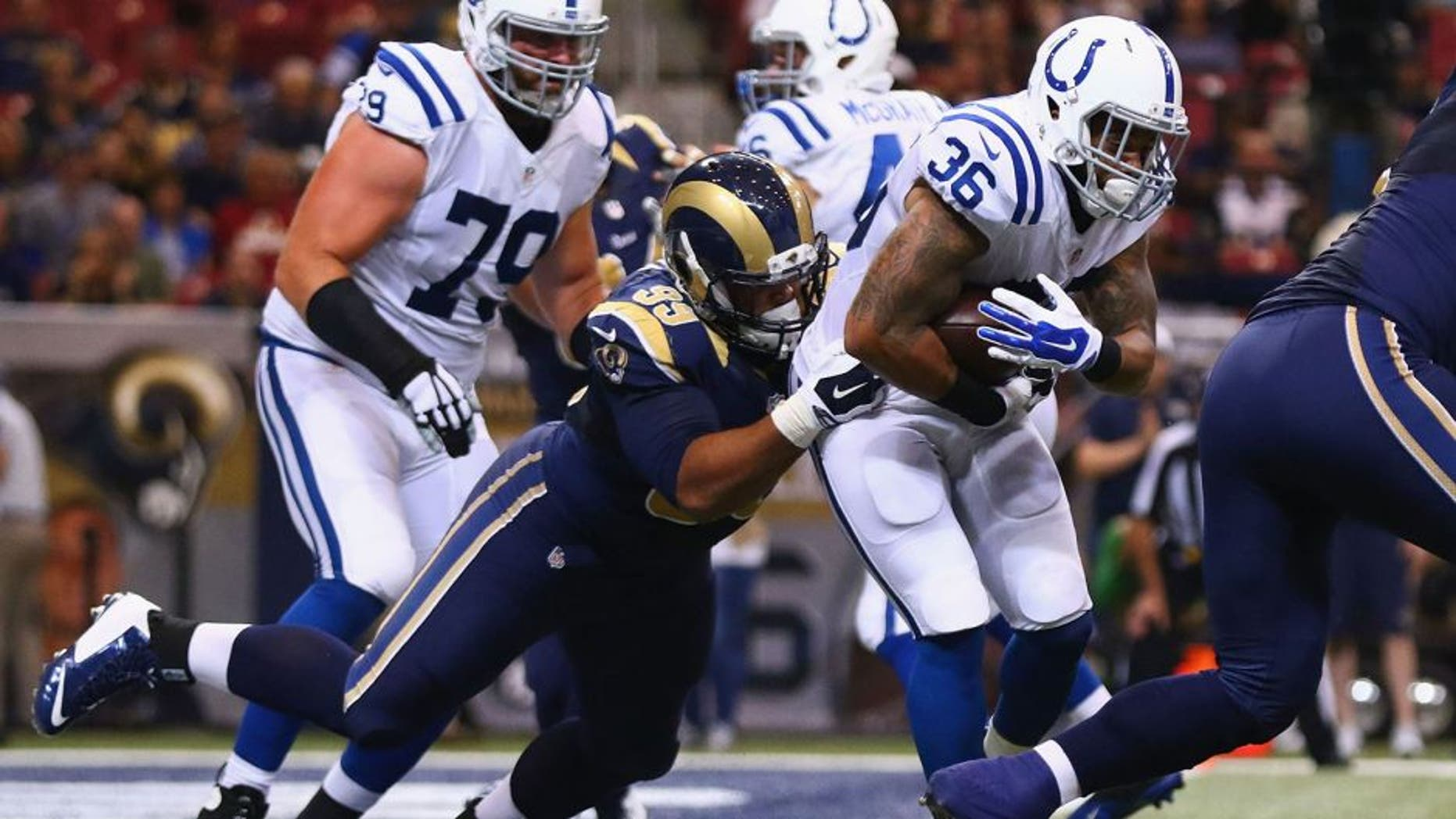 ST. LOUIS, MO - AUGUST 29: Aaron Donald #99 of the St. Louis Rams tackles Daniel Herron #36 of the Indianapolis Colts in the second quarter during a preseason game at the Edward Jones Dome on August 29, 2014 in St. Louis, Missouri. (Photo by Dilip Vishwanat/Getty Images)