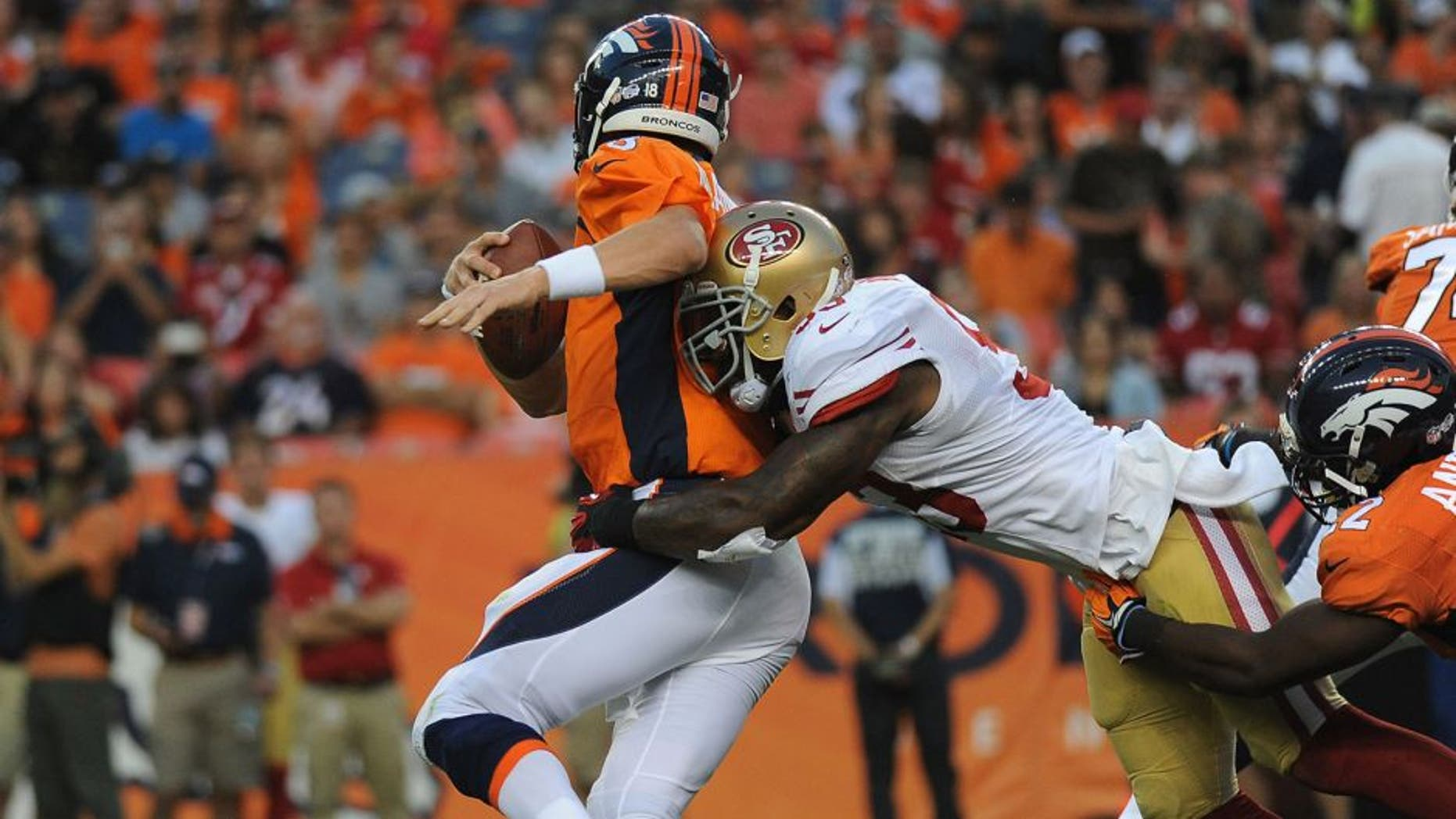DENVER, CO - AUGUST 29: Denver Broncos quarterback Peyton Manning gets sacked by San Francisco 49ers linebacker NaVorro Bowman in the first quarter at Sports Authority Field at Mile High on Saturday, August 29, 2015. (Photo by Steve Nehf/The Denver Post via Getty Images)