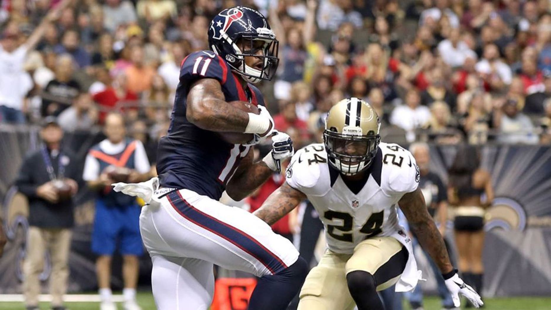 Aug 30, 2015; New Orleans, LA, USA; Houston Texans wide receiver Jaelen Strong (11) scores a touchdown in the second half of their game against the New Orleans Saints at the Mercedes-Benz Superdome. The Texans won, 27-13. Mandatory Credit: Chuck Cook-USA TODAY Sports