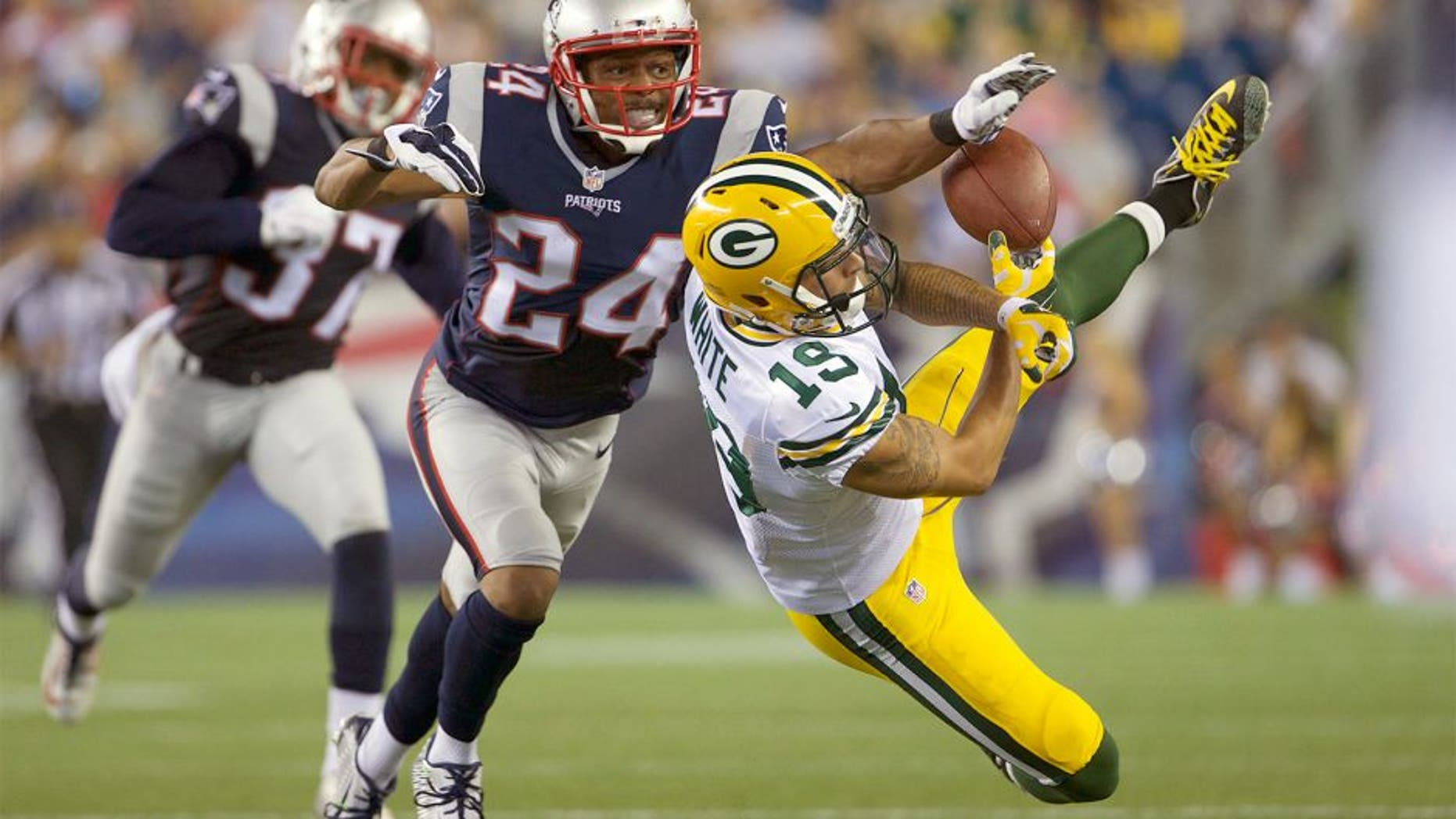 Aug 13, 2015; Foxborough, MA, USA; New England Patriots defensive back Bradley Fletcher (24) defends against Green Bay Packers wide receiver Myles White (19) during the first half in a preseason NFL football game at Gillette Stadium. Mandatory Credit: David Butler II-USA TODAY Sports