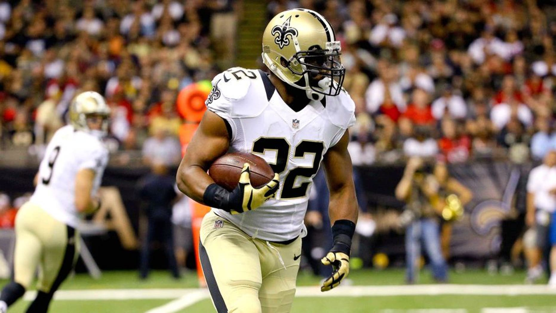 Aug 30, 2015; New Orleans, LA, USA; New Orleans Saints running back Mark Ingram (22) runs against the Houston Texans during the first quarter of a preseason game at the Mercedes-Benz Superdome. Mandatory Credit: Derick E. Hingle-USA TODAY Sports