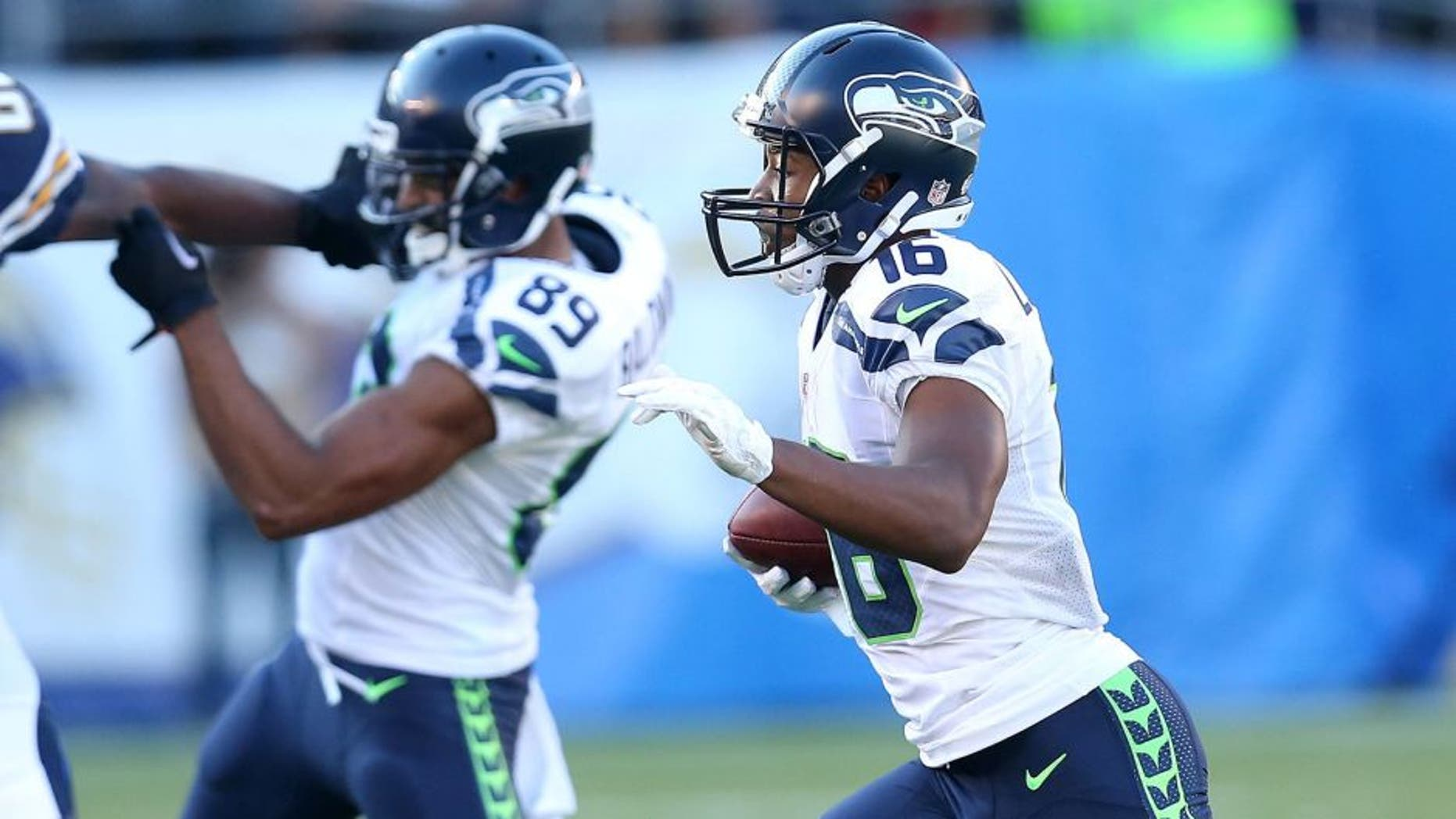 SAN DIEGO, CA - AUGUST 29: Tyler Lockett #16 of the Seattle Seahawks returns a punt 67 yards for a touchdown in the second quarter against the San Diego Chargers during preseason at Qualcomm Stadium on August 29, 2015 in San Diego, California. (Photo by Stephen Dunn/Getty Images)