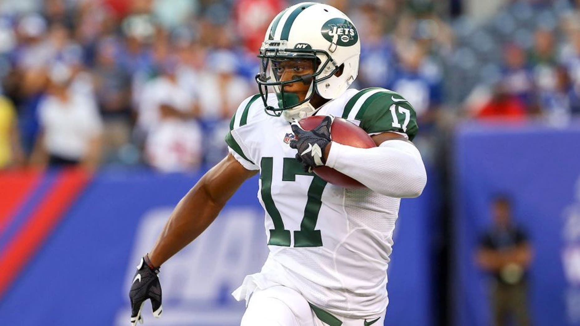 Aug 29, 2015; East Rutherford, NJ, USA; New York Jets wide receiver Chris Owusu (17) returns the opening kickoff during the first half of their game against the New York Giants at MetLife Stadium. Mandatory Credit: Ed Mulholland-USA TODAY Sports
