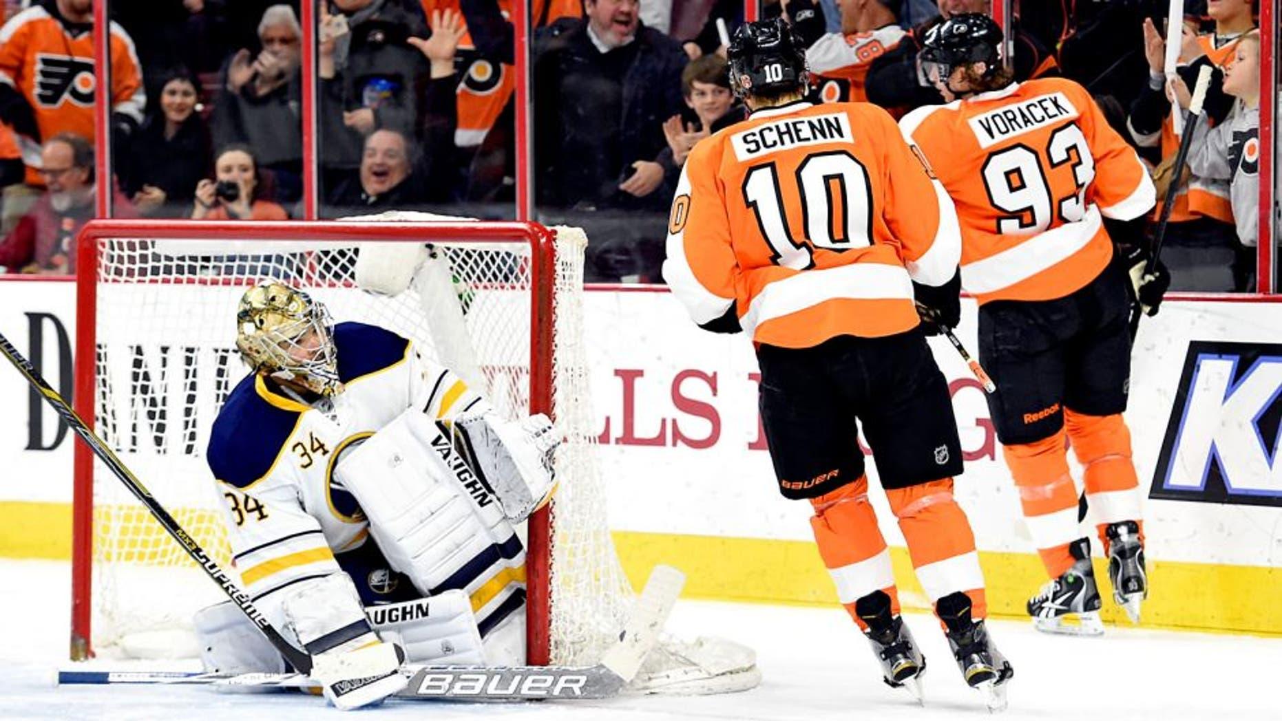 Feb 19, 2015; Philadelphia, PA, USA; Philadelphia Flyers right wing Jakub Voracek (93) celebrates his goal against Buffalo Sabres goalie Michal Neuvirth (34) during the second period at Wells Fargo Center. Mandatory Credit: Eric Hartline-USA TODAY Sports