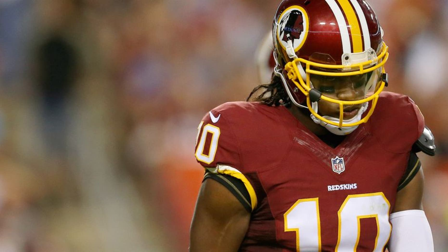 Quarterback Robert Griffin III #10 of the Washington Redskins walks off the field during a preseason game against the Detroit Lions at FedEx Field on August 20, 2015 in Landover, Maryland. (Photo by Matt Hazlett/Getty Images)