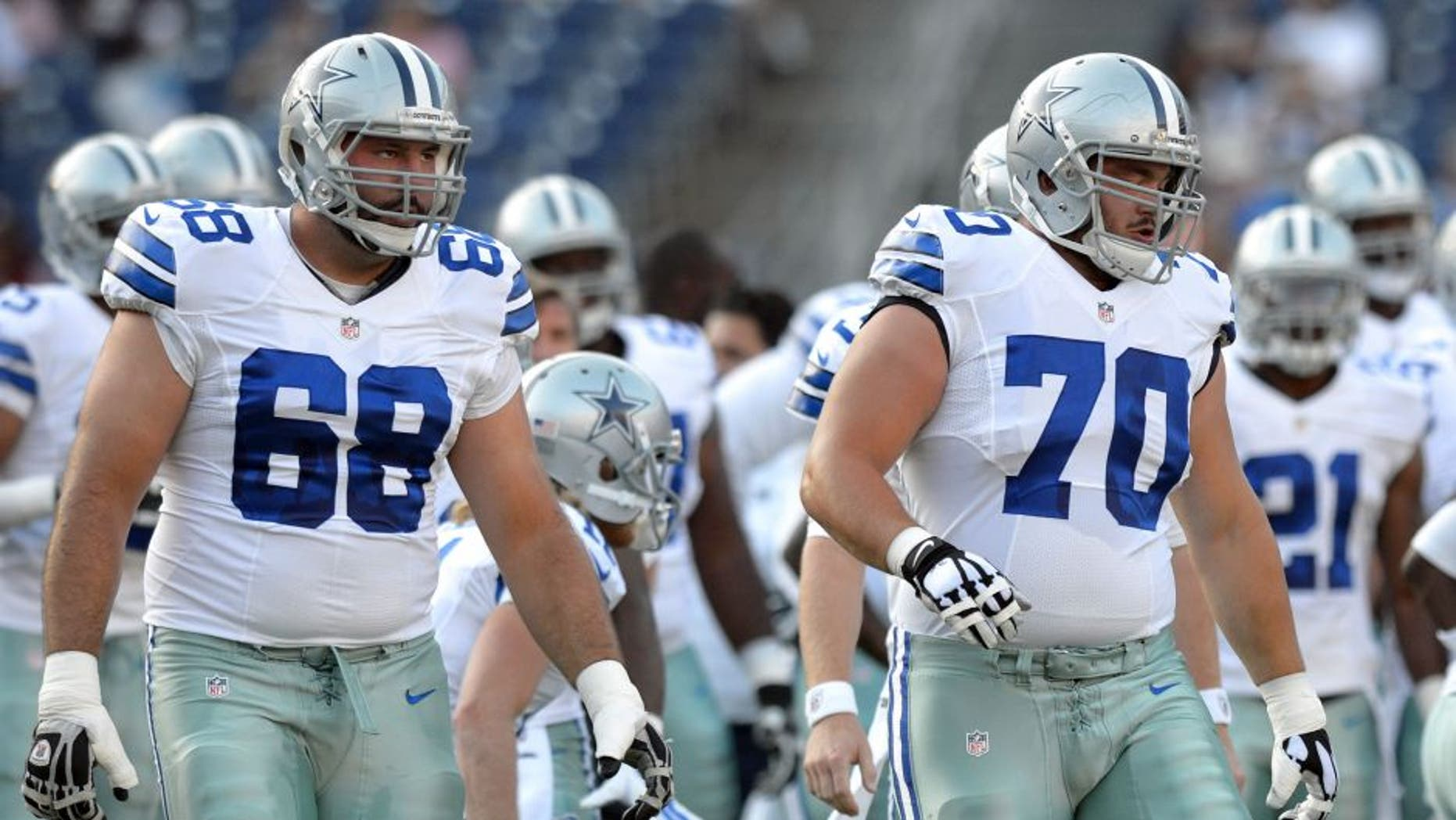 Aug 7, 2014; San Diego, CA, USA; Dallas Cowboys tackle Doug Free (68) and guard Zack Martin (70) warm-up before the game against the San Diego Chargers at Qualcomm Stadium. Mandatory Credit: Jake Roth-USA TODAY Sports