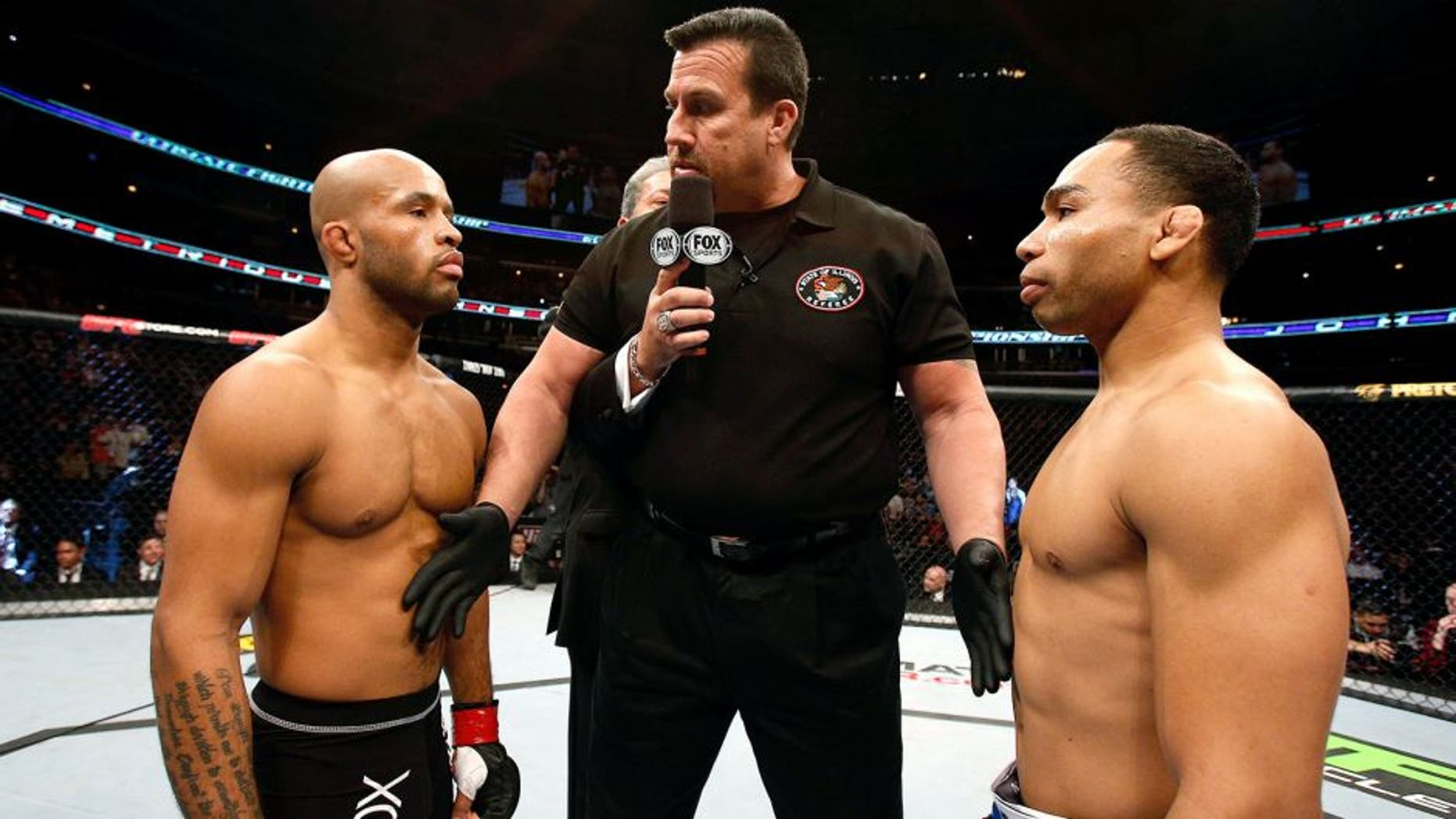 CHICAGO, IL - JANUARY 26: John Dodson (R) face off with Demetrious Johnson (L) during thier Flyweight Championship Bout part of UFC on FOX at United Center on January 26, 2013 in Chicago, Illinois. (Photo by Josh Hedges/Zuffa LLC/Zuffa LLC Via Getty Images)