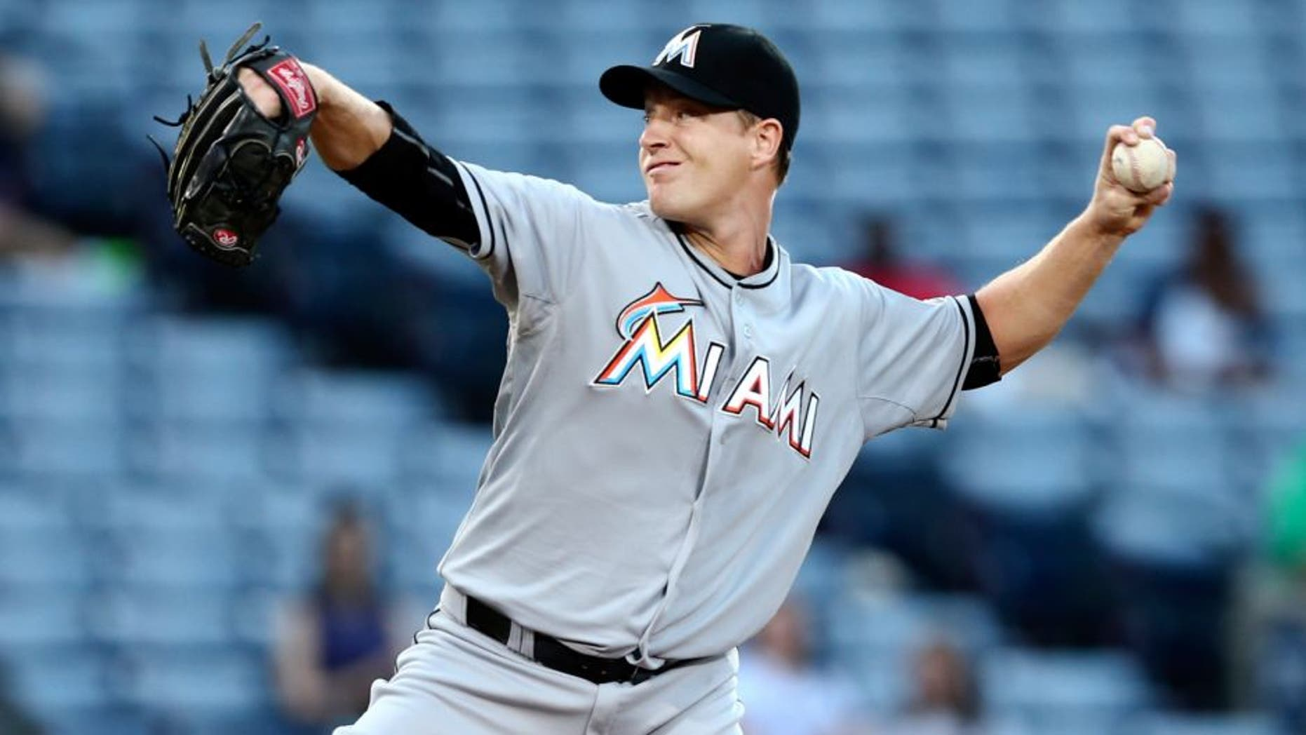 Miami Marlins starting pitcher Chris Narveson (45) works in the first inning of a baseball game against the Atlanta Braves Monday, Aug. 31, 2015, in Atlanta. (AP Photo/John Bazemore)