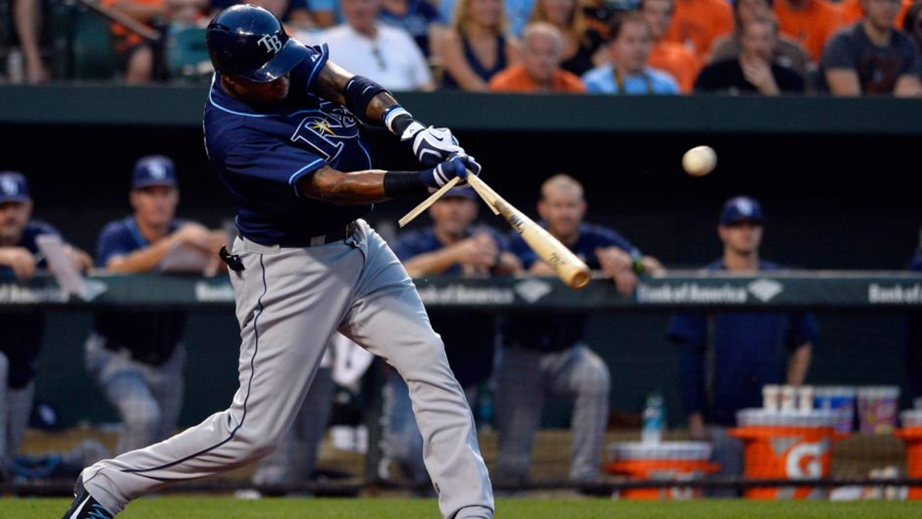 Aug 31, 2015; Baltimore, MD, USA; Tampa Bay Rays designated hitter Tim Beckham (1) hits a sacrifice fly scoring second baseman Logan Forsythe (not pictured) during the second inning against the Baltimore Orioles at Oriole Park at Camden Yards. Mandatory Credit: Tommy Gilligan-USA TODAY Sports