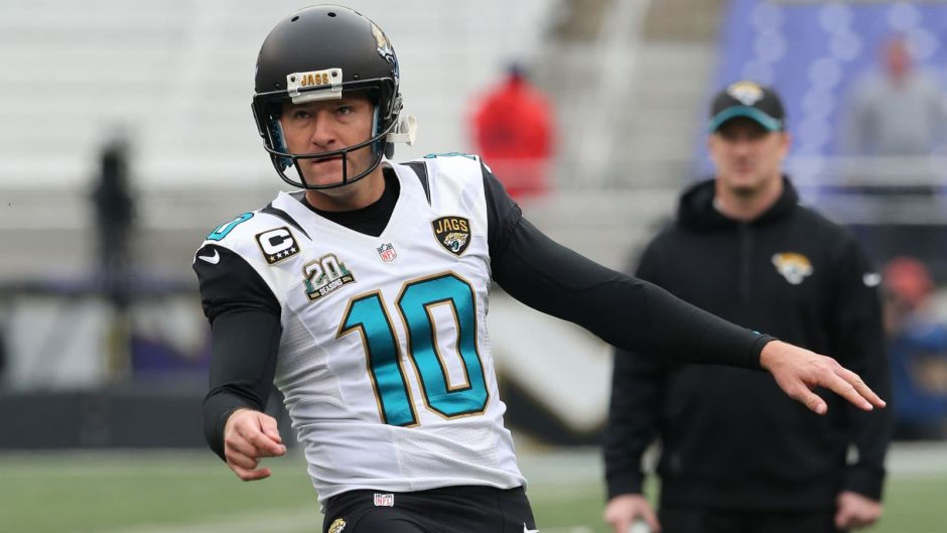 Dec 14, 2014; Baltimore, MD, USA; Jacksonville Jaguars kicker Josh Scobee (10) warms up prior to the game against the Baltimore Ravens at M&T Bank Stadium. Mandatory Credit: Mitch Stringer-USA TODAY Sports