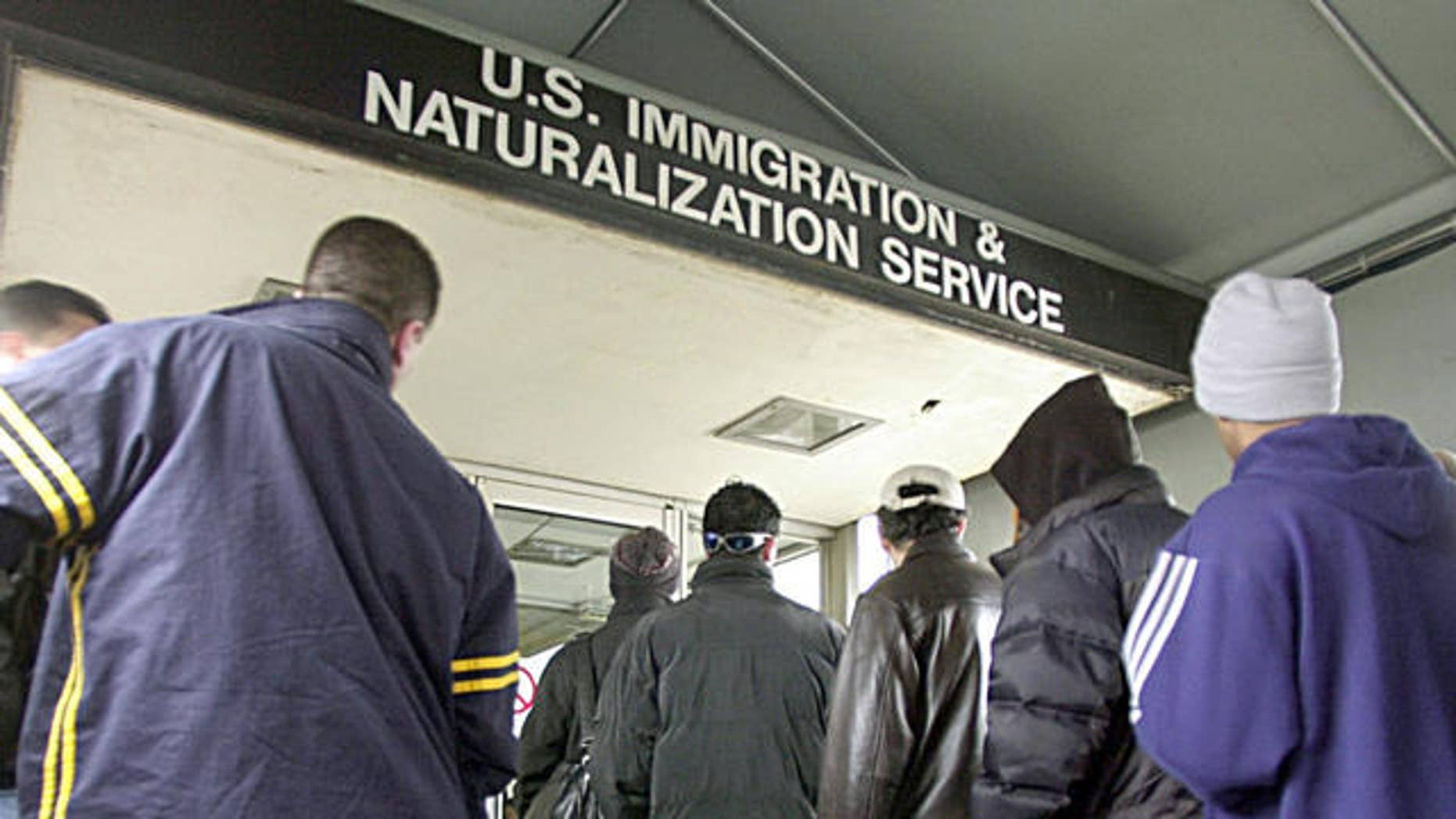 Immigrants line up outside an immigration office in Michigan. The state's governor, Rick Snyder, Republican, says foreign nationals have been an asset to the state and that Michigan's ailing economy needs to attract more immigrants.