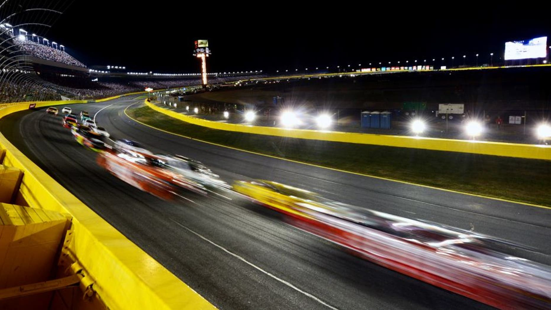 CHARLOTTE, NC - MAY 16: Cars race during the NASCAR Sprint Cup Series Sprint All-Star Race at Charlotte Motor Speedway on May 16, 2015 in Charlotte, North Carolina. (Photo by Drew Hallowell/Getty Images)