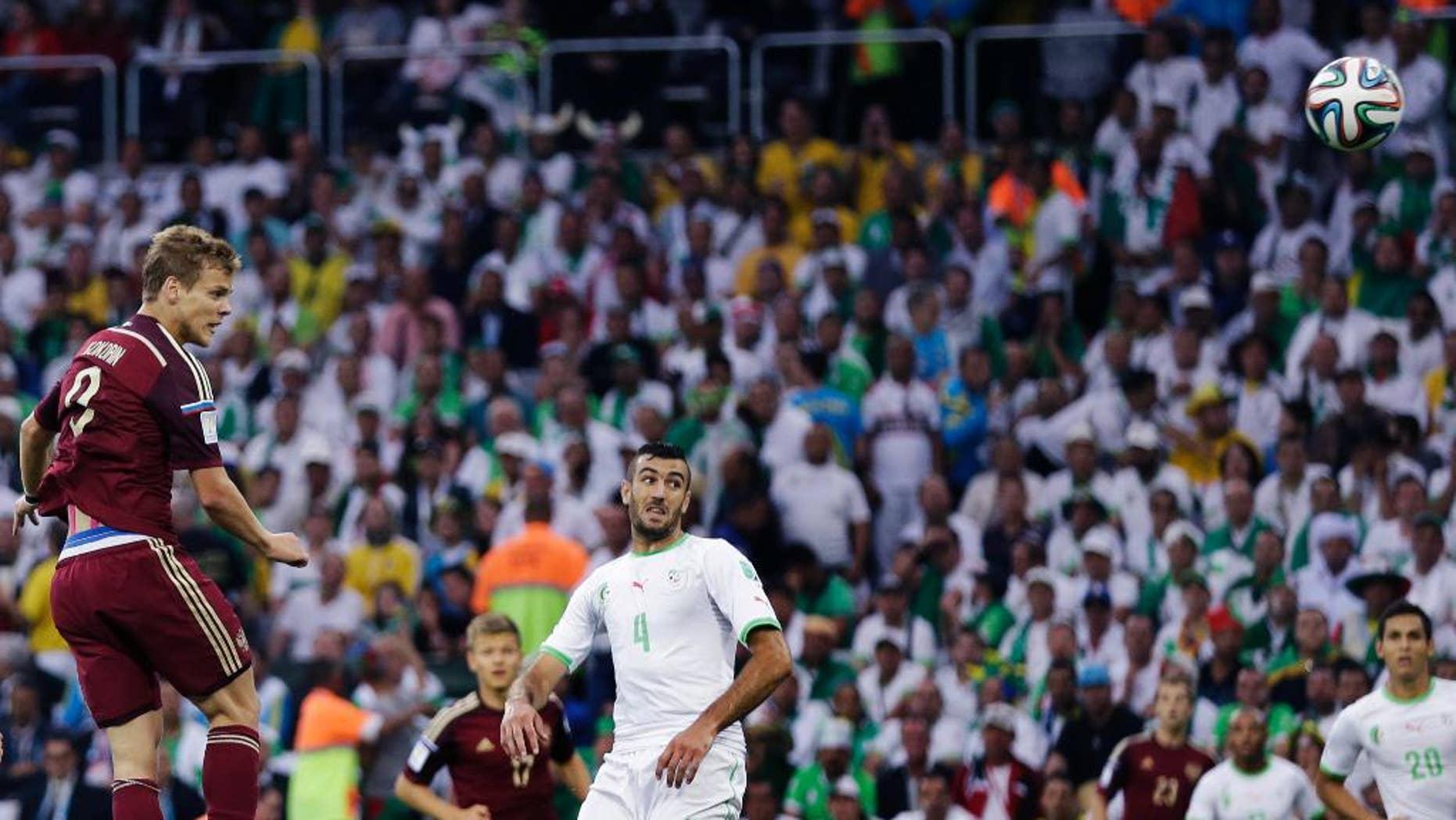 Russia's Alexander Kokorin heads the ball to score during the group H World Cup soccer match between Algeria and Russia at the Arena da Baixada in Curitiba, Brazil, Thursday, June 26, 2014. (AP Photo/Fernando Vergara)
