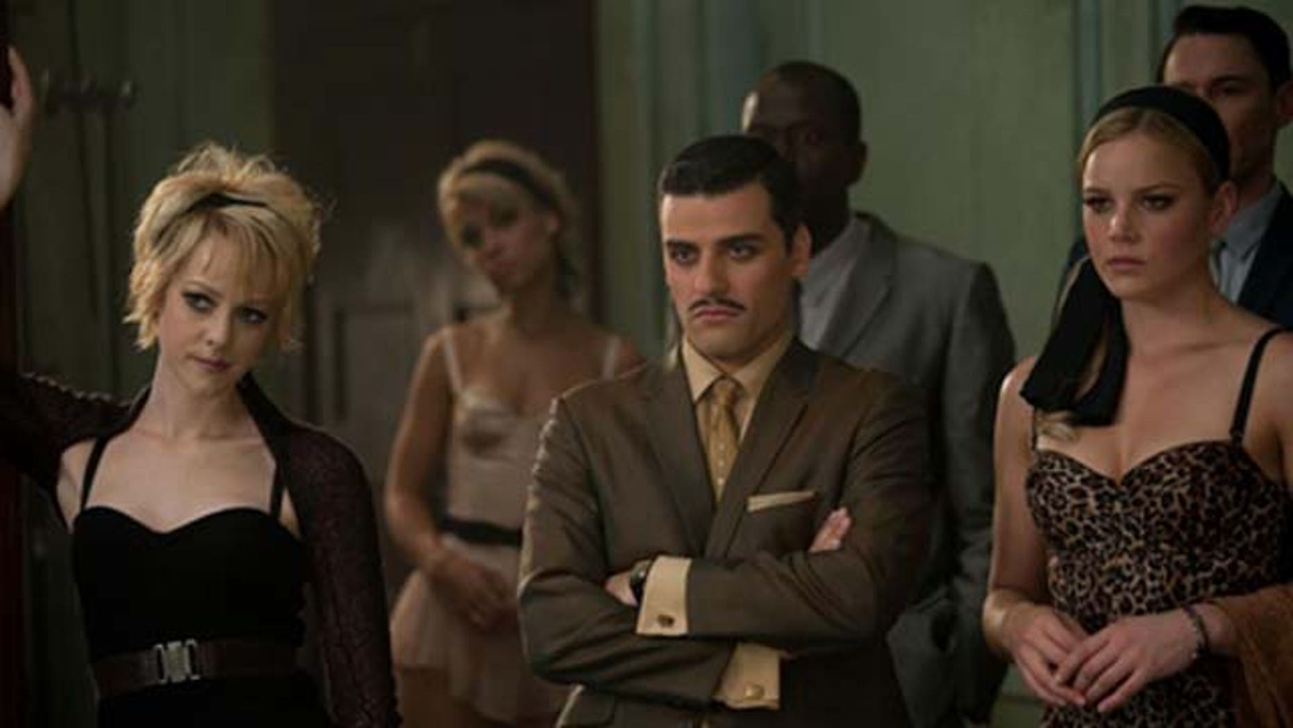 """(Front row l-r) JENA MALONE as Rocket, OSCAR ISAAC as Blue Jones and ABBIE CORNISH as Sweet Pea in Warner Bros. Pictures' and Legendary Pictures' epic action fantasy """"SUCKER PUNCH,"""" a Warner Bros. Pictures release."""