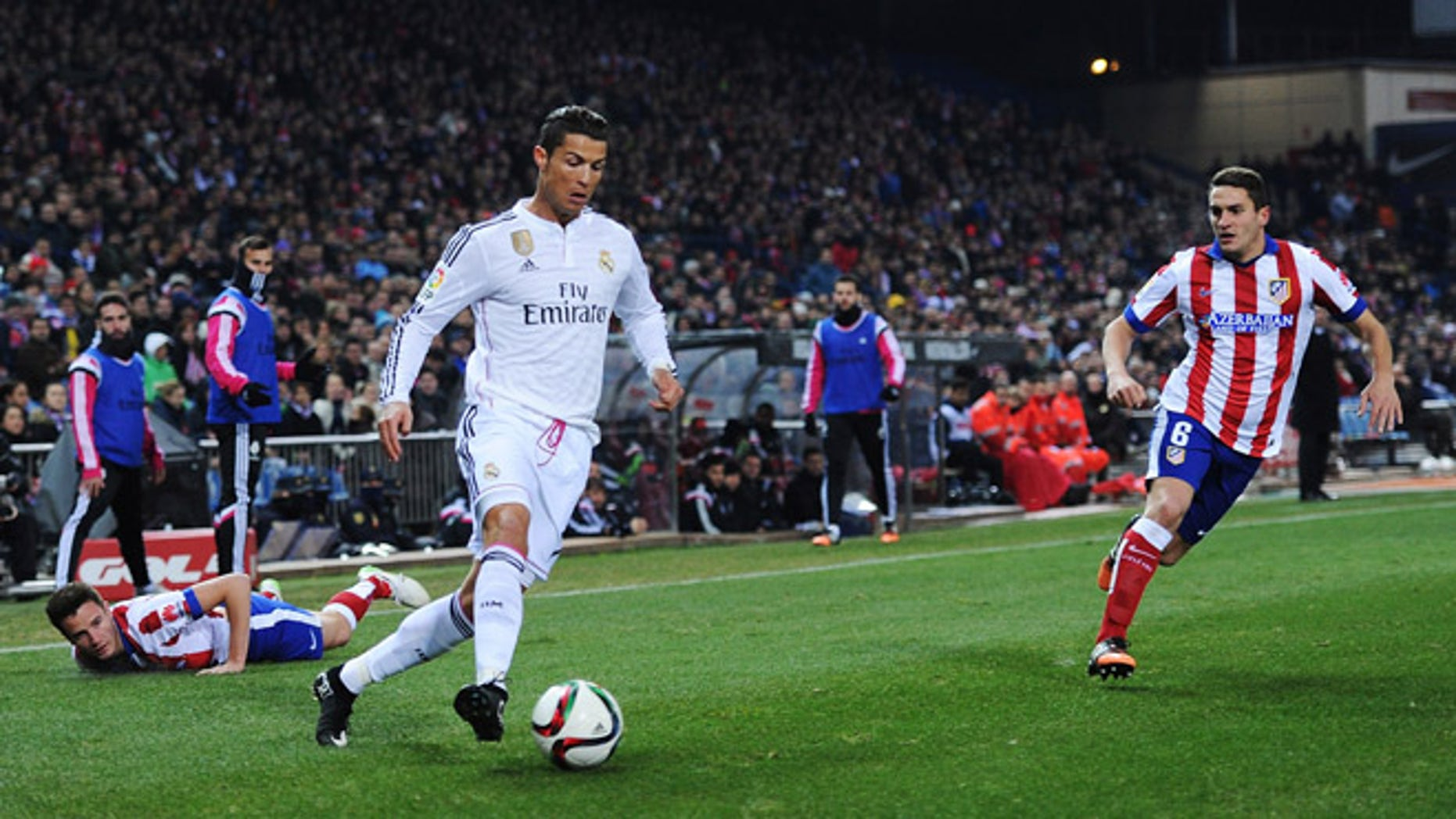 Cristiano Ronaldo gets past Ruben Mesa during match between Club Atletico and Real Madrid on January 7, 2015 in Madrid, Spain.