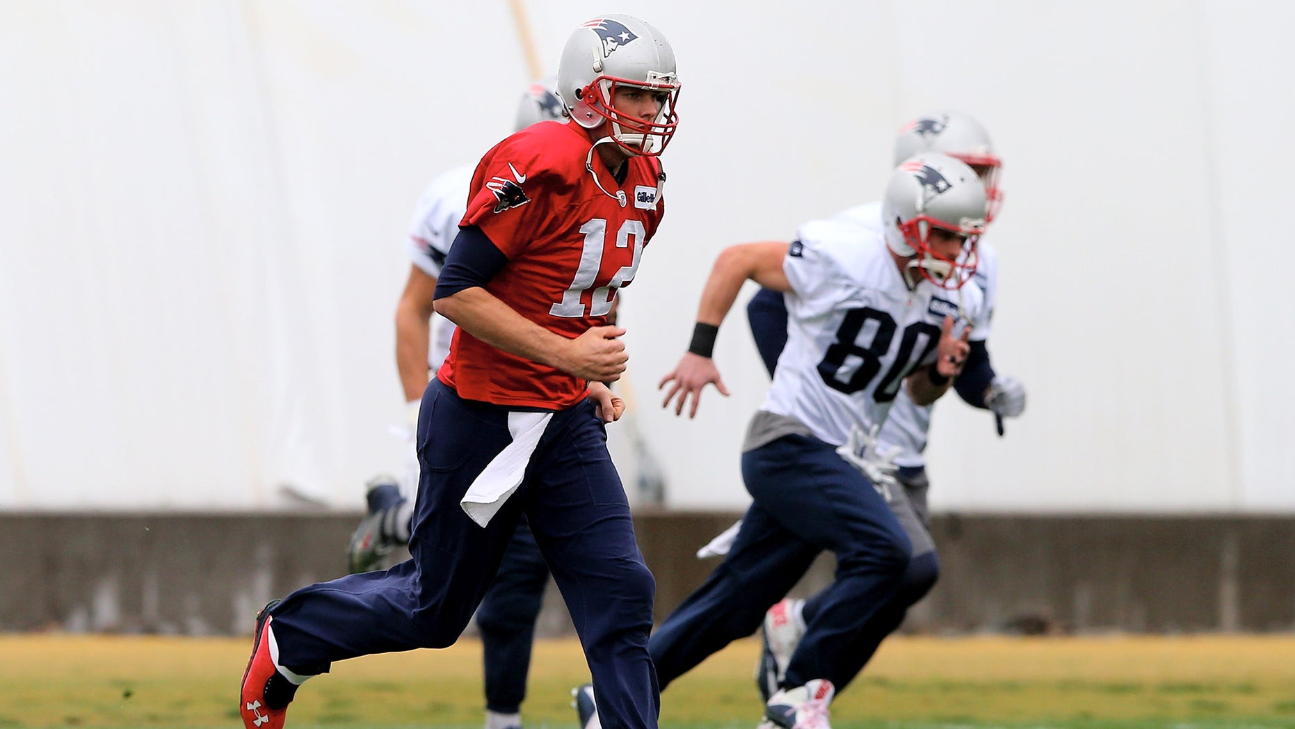 TEMPE, AZ - JANUARY 30:  Tom Brady #12 of the New England Patriots warms up during the New England Patriots Super Bowl XLIX Practice on January 30, 2015 at the Arizona Cardinals Practice Facility in Tempe, Arizona.  (Photo by Elsa/Getty Images)