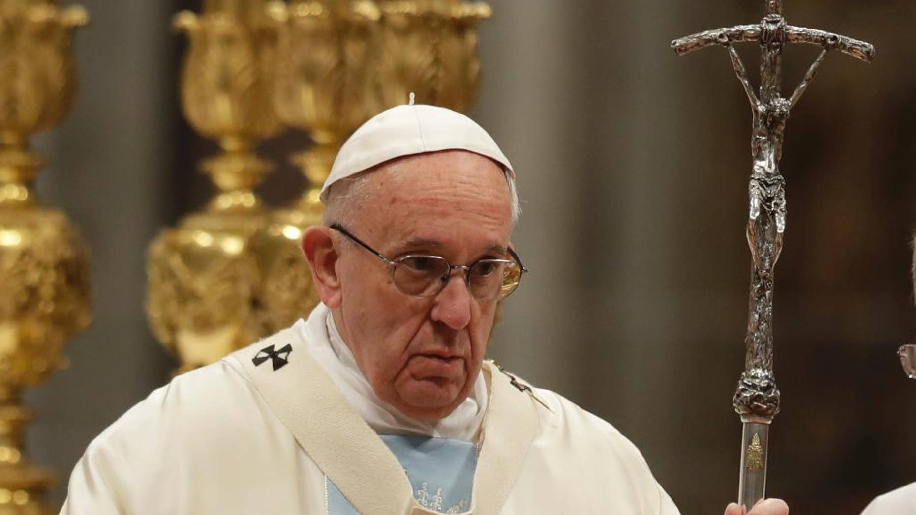 Pope Francis celebrates a new year's Mass in St. Peter's Basilica at the Vatican, Sunday, Jan. 1, 2017. (AP Photo/Andrew Medichini)