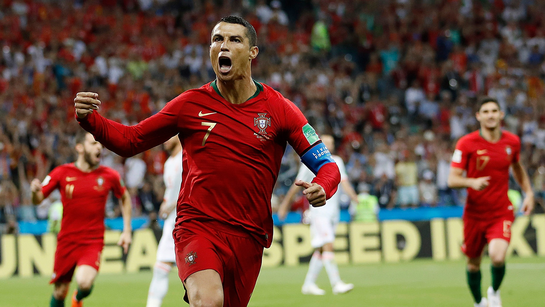 Portugal's Cristiano Ronaldo celebrates his side's opening goal during the group B match between Portugal and Spain at the 2018 soccer World Cup in Sochi, Russia, Friday, June 15, 2018. (AP Photo/Francisco Seco)