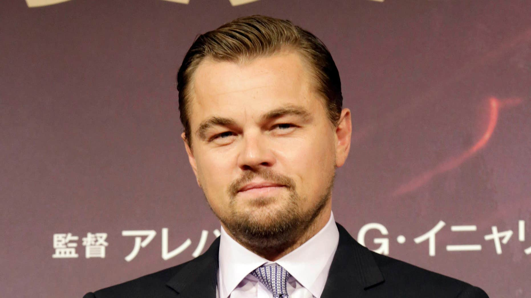 """FILE - In this March 23, 2016 file photo, actor Leonardo DiCaprio poses during a photo session of the movie """"The Revenant"""" in Tokyo."""