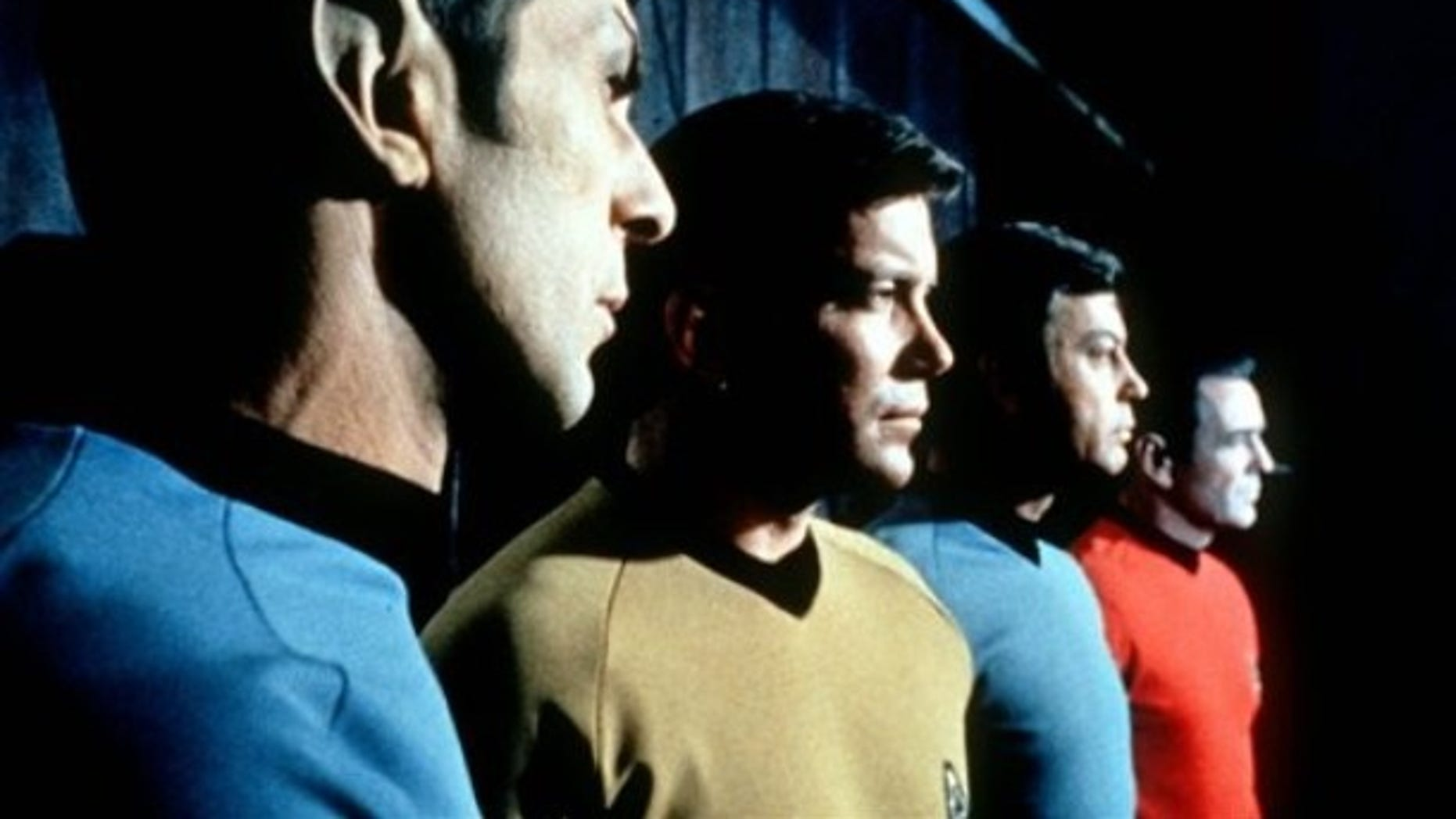"""FILE- This undated file photo shows actors in the TV series """"Star Trek,"""" from left, Leonard Nimoy as Commander Spock, William Shatner as Captain Kirk, DeForest Kelley as Doctor McCoy and James Doohan as Commander Scott. (AP Photo/Paramount Television ,File) ** NO SALES **"""