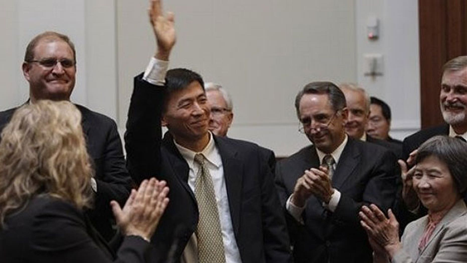 August 31: University of California, Berkeley law professor Goodwin Liu waves after he was confirmed by a three member appointment board of the Commission on Judicial Appointments in San Francisco.