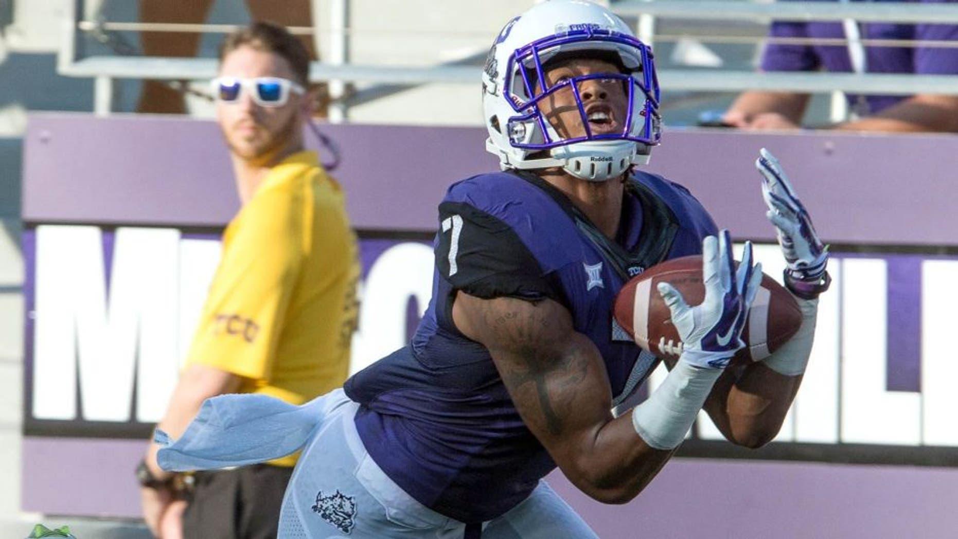 Aug 30, 2014; Fort Worth, TX, USA; TCU Horned Frogs wide receiver Kolby Listenbee (7) catches a touchdown pass as Samford Bulldogs defensive back James Bradberry (21) defends during the first quarter at Amon G. Carter Stadium. Mandatory Credit: Jerome Miron-USA TODAY Sports