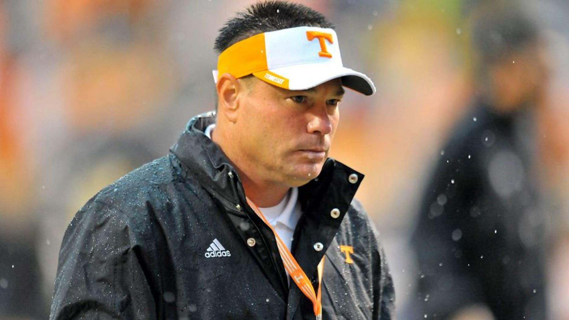 Aug 31, 2014; Knoxville, TN, USA; Tennessee Volunteers head coach Butch Jones leaves the field after warm ups prior to the game against the Utah State Aggies at Neyland Stadium. Mandatory Credit: Jim Brown-USA TODAY Sports