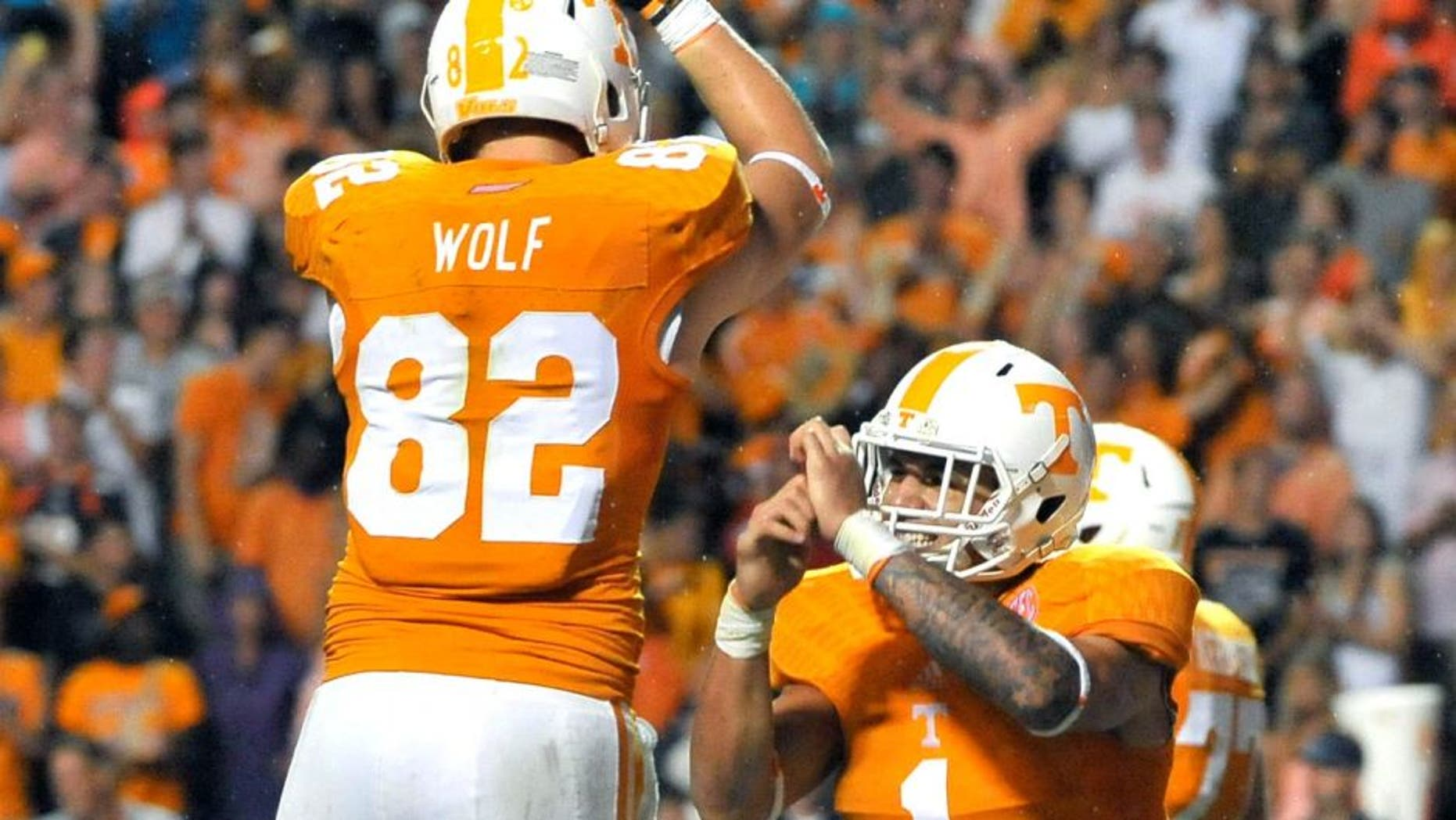 Aug 31, 2014; Knoxville, TN, USA; Tennessee Volunteers running back Jalen Hurd (1) celebrates scoring his first college career touchdown against the Utah State Aggies with teammate Tennessee tight end Ethan Wolf (82) during the second half at Neyland Stadium. Tennessee won 38-7. Mandatory Credit: Jim Brown-USA TODAY Sports