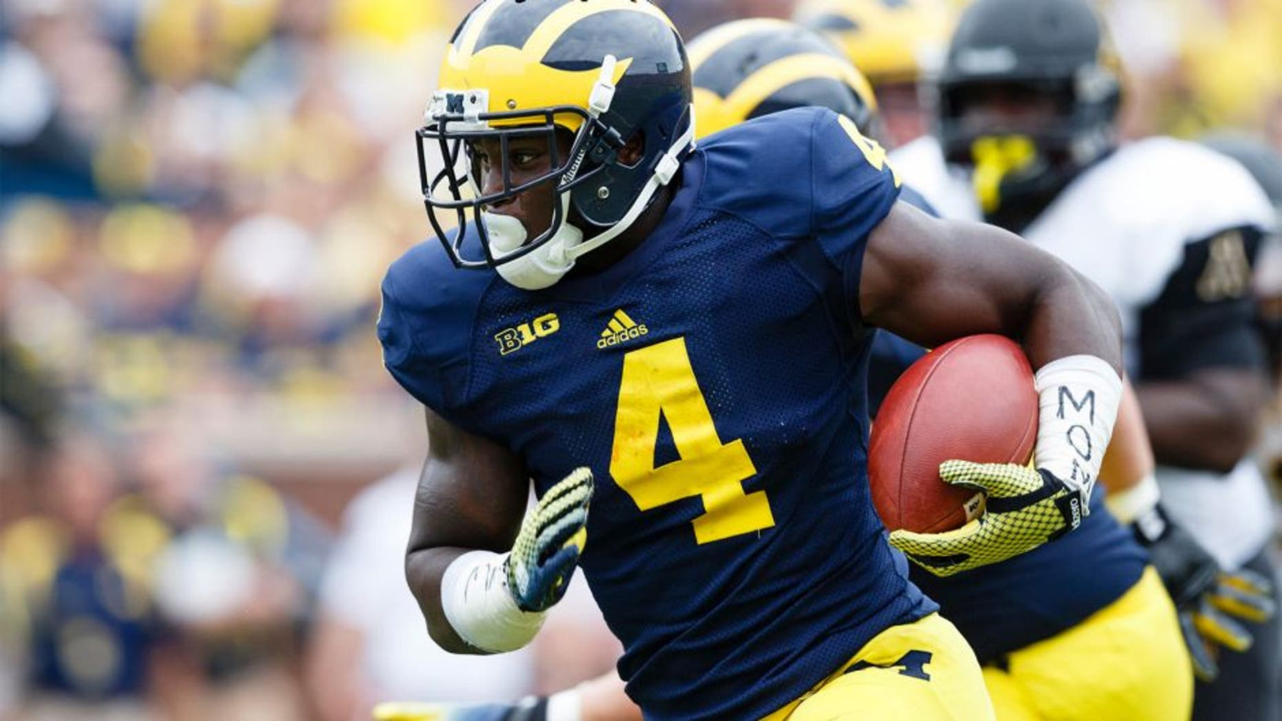 Aug 30, 2014; Ann Arbor, MI, USA; Michigan Wolverines running back De'Veon Smith (4) rushes for a touchdown in the third quarter against the Appalachian State Mountaineers at Michigan Stadium. Michigan won 52-14. Mandatory Credit: Rick Osentoski-USA TODAY Sports