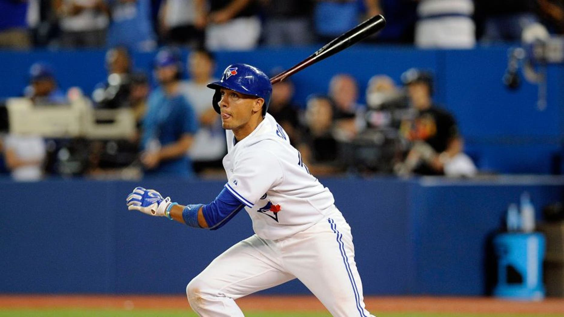Aug 31, 2015; Toronto, Ontario, CAN; Toronto Blue Jays second baseman Ryan Goins (17) hits a single in the ninth inning against Cleveland Indians at Rogers Centre. Indians beat Jay 4 - 2. Mandatory Credit: Peter Llewellyn-USA TODAY Sports