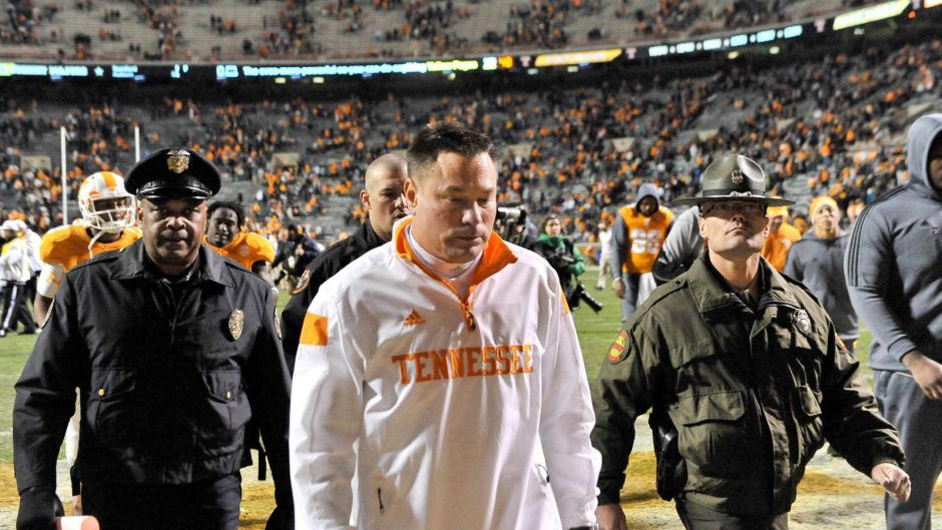 Nov 22, 2014; Knoxville, TN, USA; Tennessee Volunteers head coach Butch Jones leaves the field after his team lost to the Missouri Tigers during the second half at Neyland Stadium. Missouri won 29-21. Mandatory Credit: Jim Brown-USA TODAY Sports
