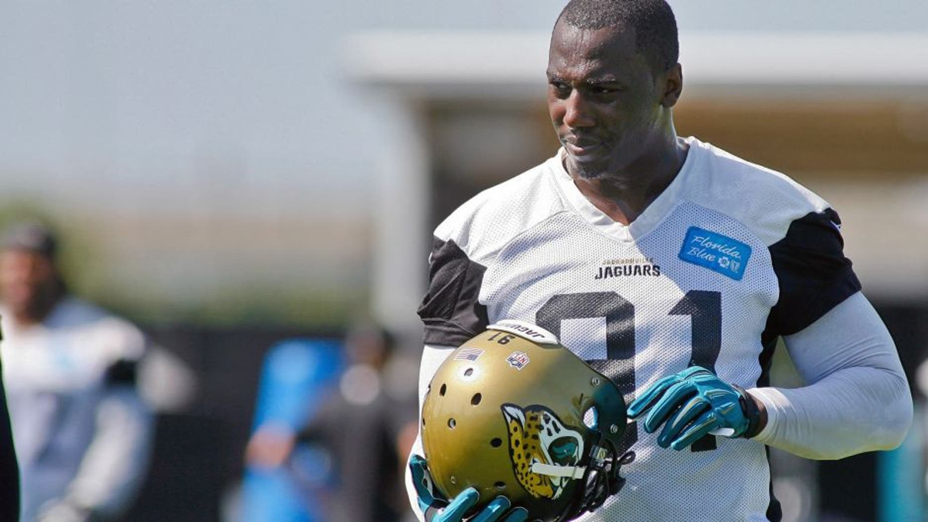 Jun 16, 2015; Jacksonville, FL, USA; Jacksonville Jaguars defensive end Chris Clemons (91) during minicamp at the Florida Blue Health and Wellness Practice Fields. Mandatory Credit: Phil Sears-USA TODAY Sports